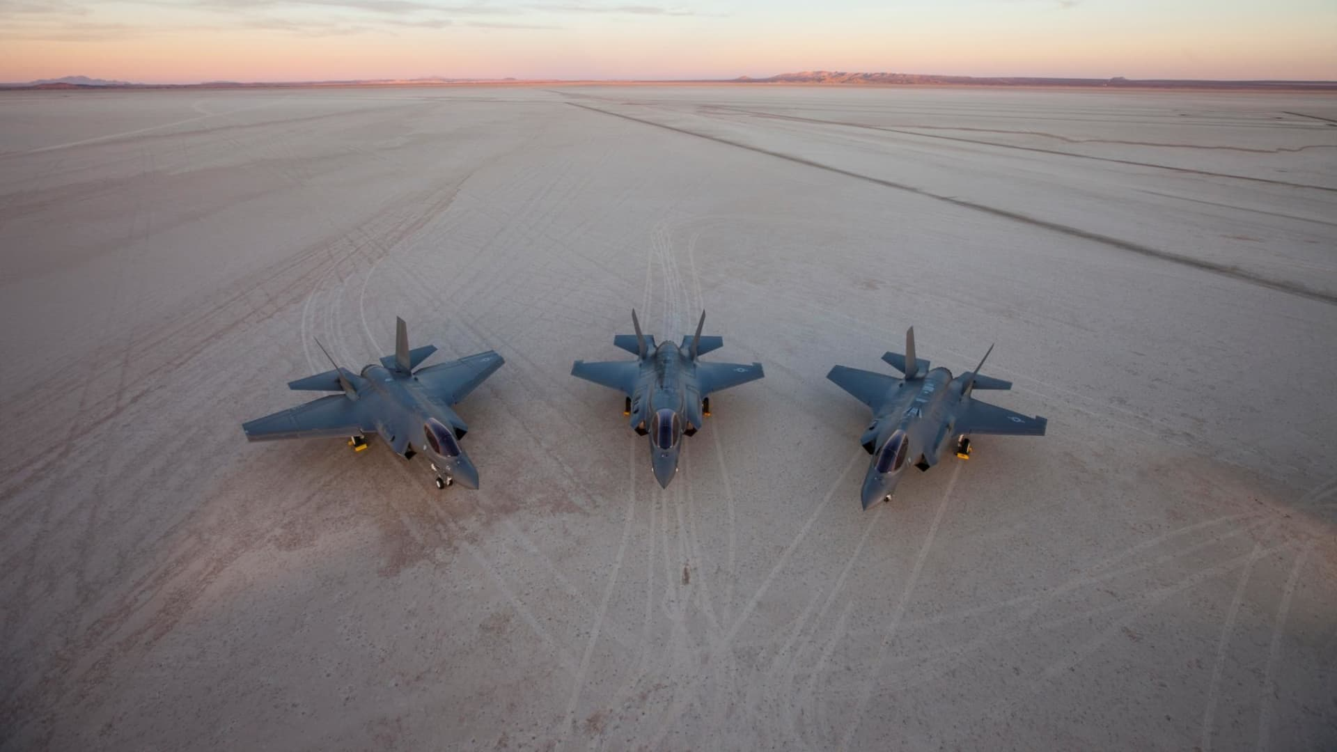 All three F-35 variants at Edwards Air Force Base, California: the Navy's F-35C, the Marine Corps' F-35B, and the Air Force's F-35A variant.