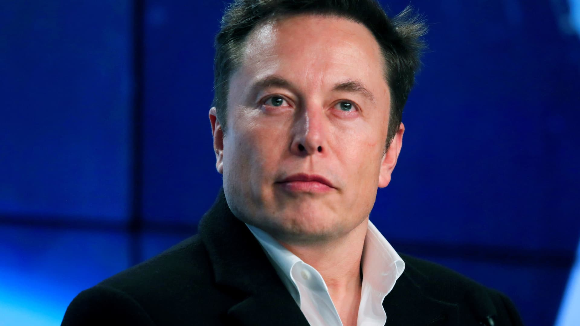 SpaceX founder Elon Musk looks on at a post-launch news conference after the SpaceX Falcon 9 rocket, carrying the Crew Dragon spacecraft, lifted off on an uncrewed test flight to the International Space Station from the Kennedy Space Center in Cape Canaveral, Florida, March 2, 2019.
