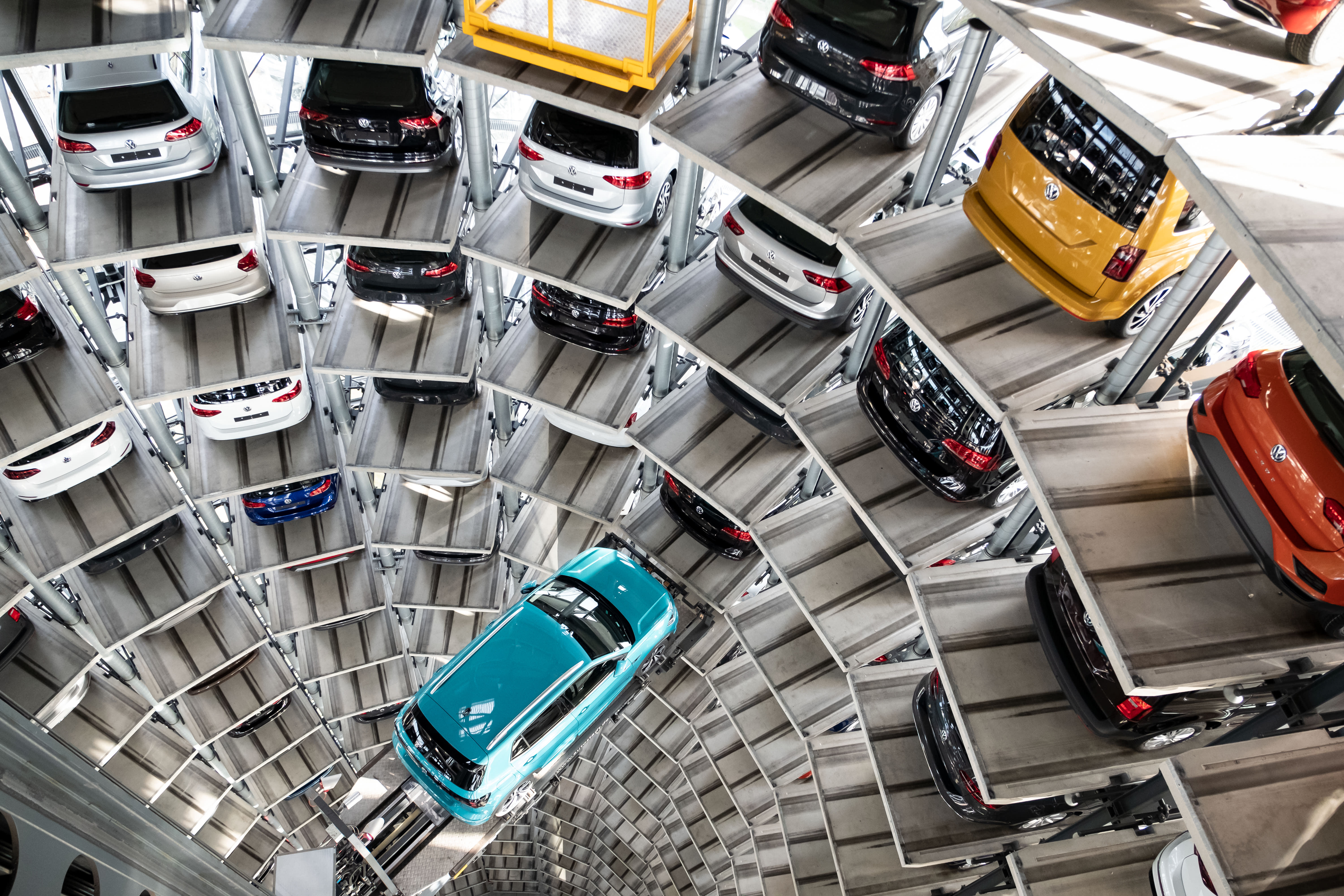 The Volkswagen T-Cross model stands on a lifting platform in a car tower on the Volkswagen factory premises.