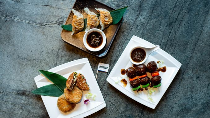 Impossible Food's ground beef reinvented as gyoza, crisp pancakes and meatball skewers at Empress in Singapore.