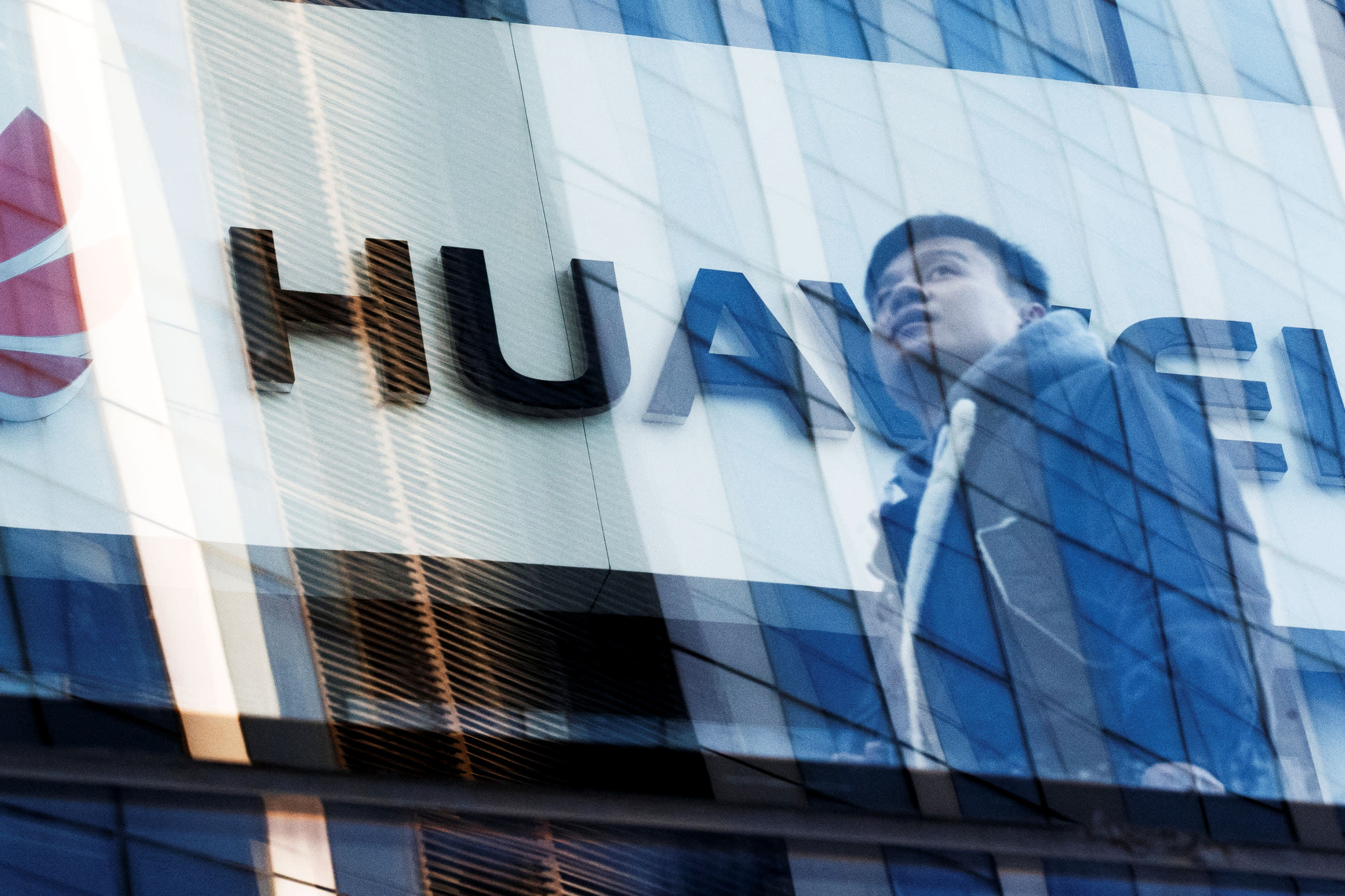 A man walks past a Huawei shop in Beijing, China, March 7, 2019.