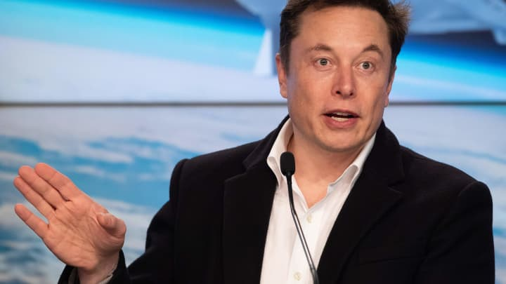 Elon Musk says Tesla still plans to offer insurance, but is waiting for an acquisition to close