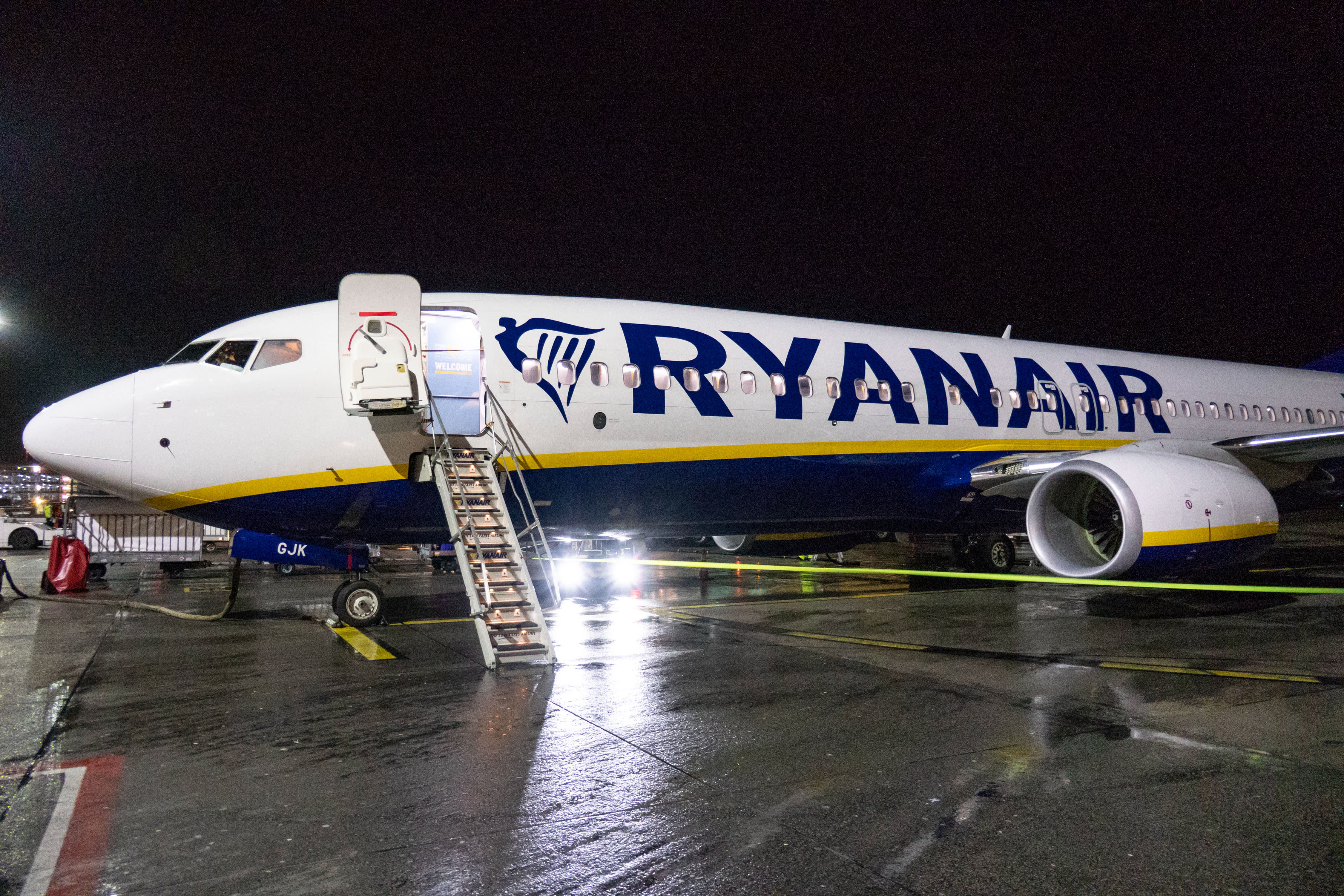 A Ryanair Boeing 737-800 aircraft parked at Eindhoven airport tarmac at night, in the Netherlands.