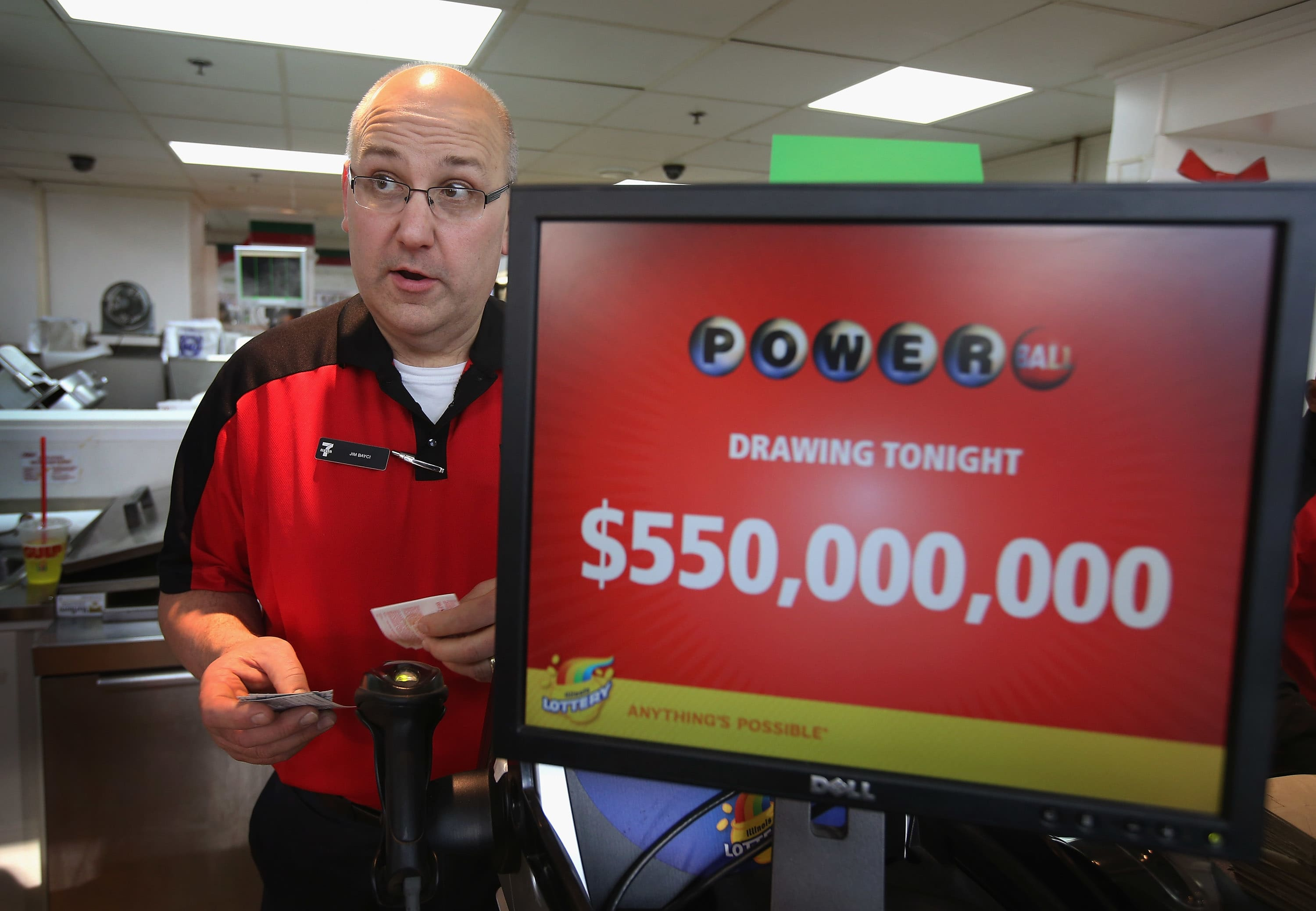 A store owner prints a Powerball lottery ticket for a customer at his 7-Eleven store on in Chicago, Illinois.