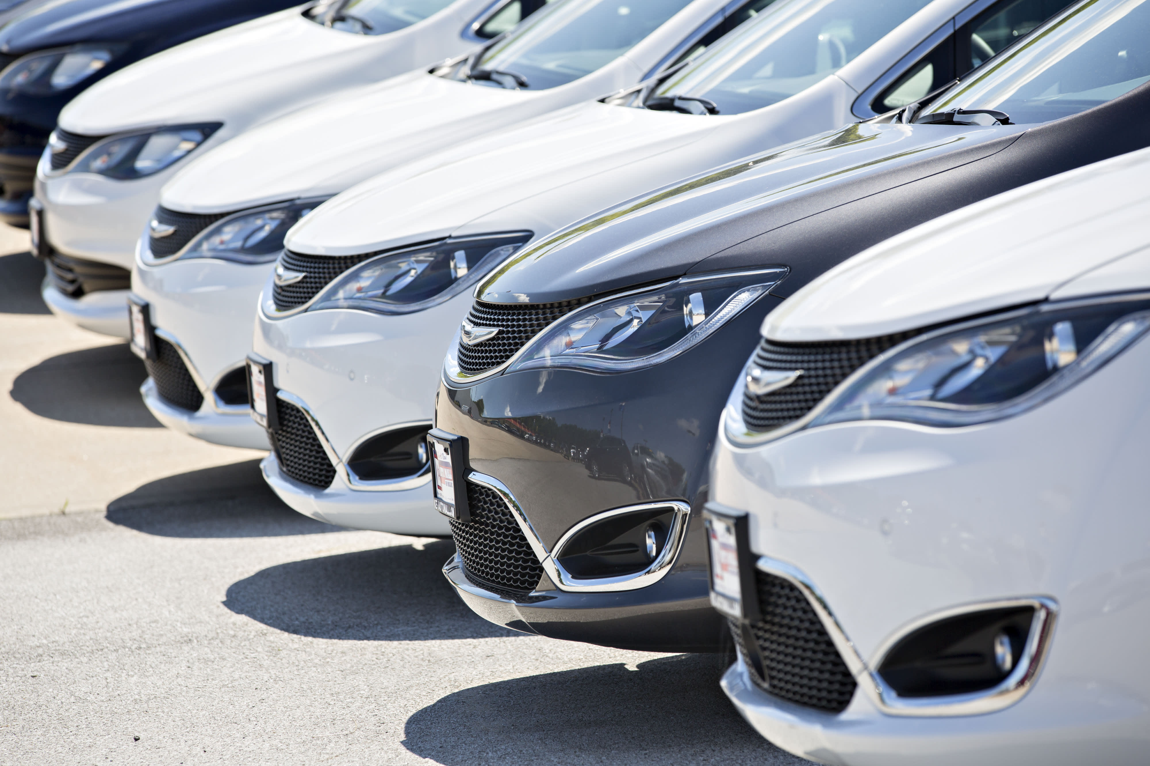 A row of Fiat Chrysler Automobiles (FCA) 2017 Chrysler Pacifica minivan vehicles are displayed for sale at a car dealership in Moline, Illinois, on July 1, 2017.