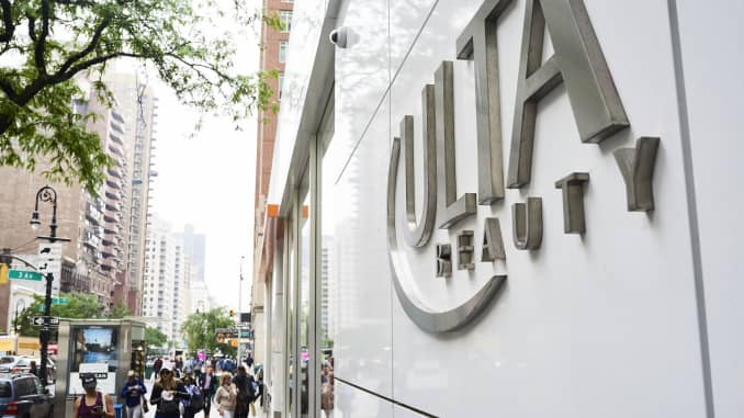 Pedestrians pass in front of an Ulta Beauty store in New York.