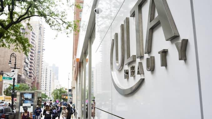 Pedestrians pass in front of an Ulta Beauty store in New York.