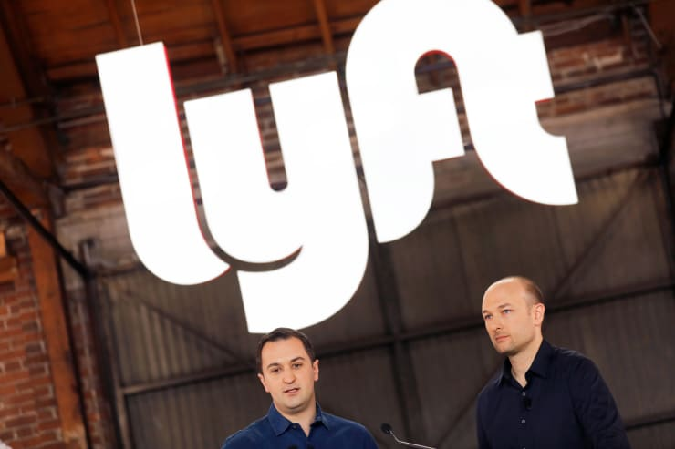Lyft President John Zimmer (R) and CEO Logan Green speak as Lyft lists on the Nasdaq at an IPO event in Los Angeles March 29, 2019.