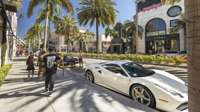 High end luxury stores and businesses on Rodeo Drive in the Beverly Hills shopping district of Los Angeles California USA. Rodeo drive is a famous high-end shopping street featuring a variety of renowned designer shops, hotels & restaurants. Beverly Hills