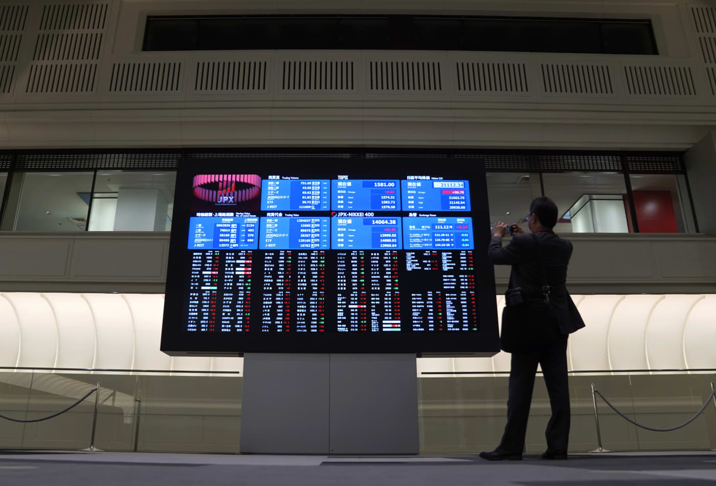 Stocks in Asia slip as investors continue to weigh impact of coronavirus