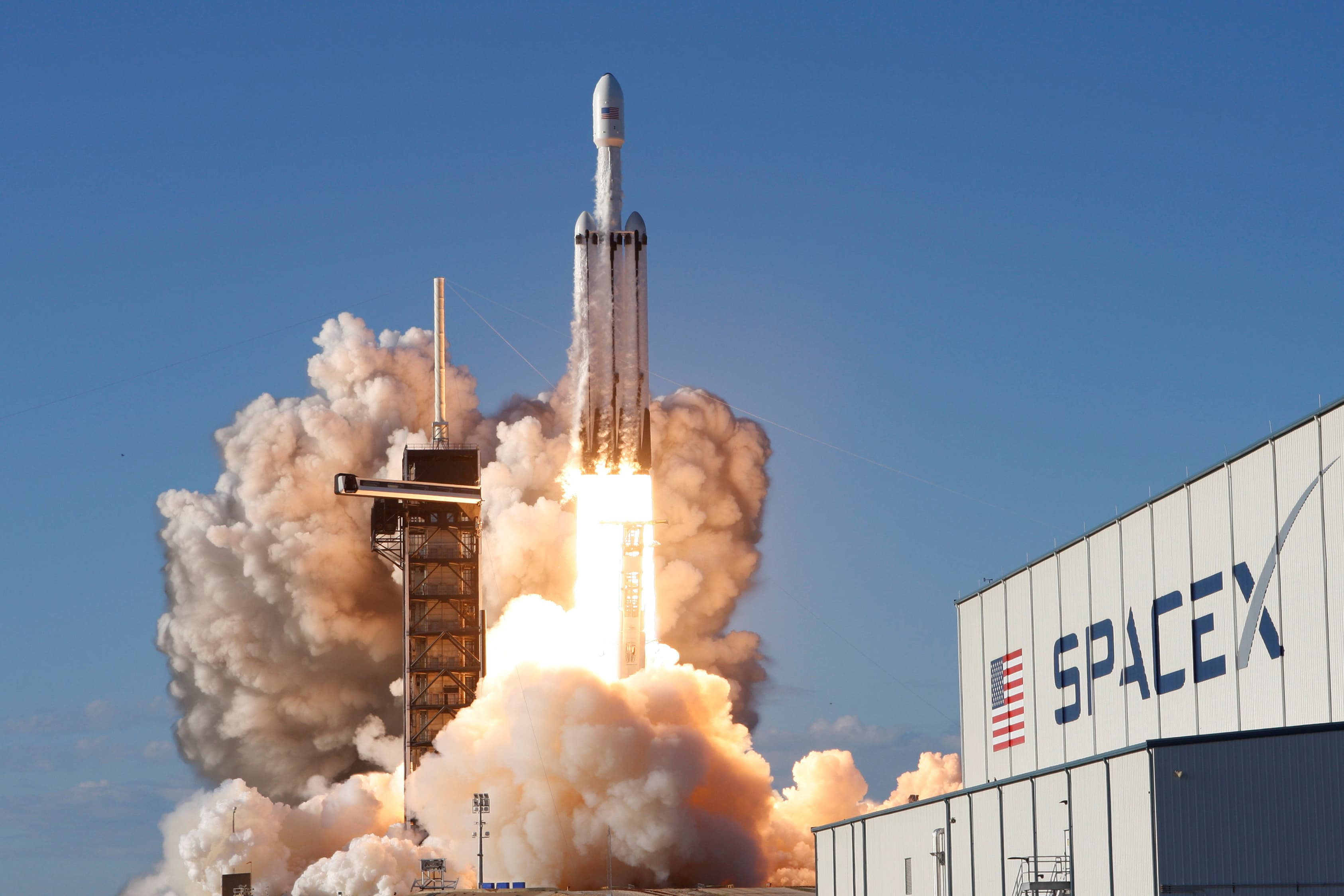 A SpaceX Falcon Heavy rocket, carrying the Arabsat 6A communications satellite, lifts off from the Kennedy Space Center in Cape Canaveral, Florida, April 11, 2019.