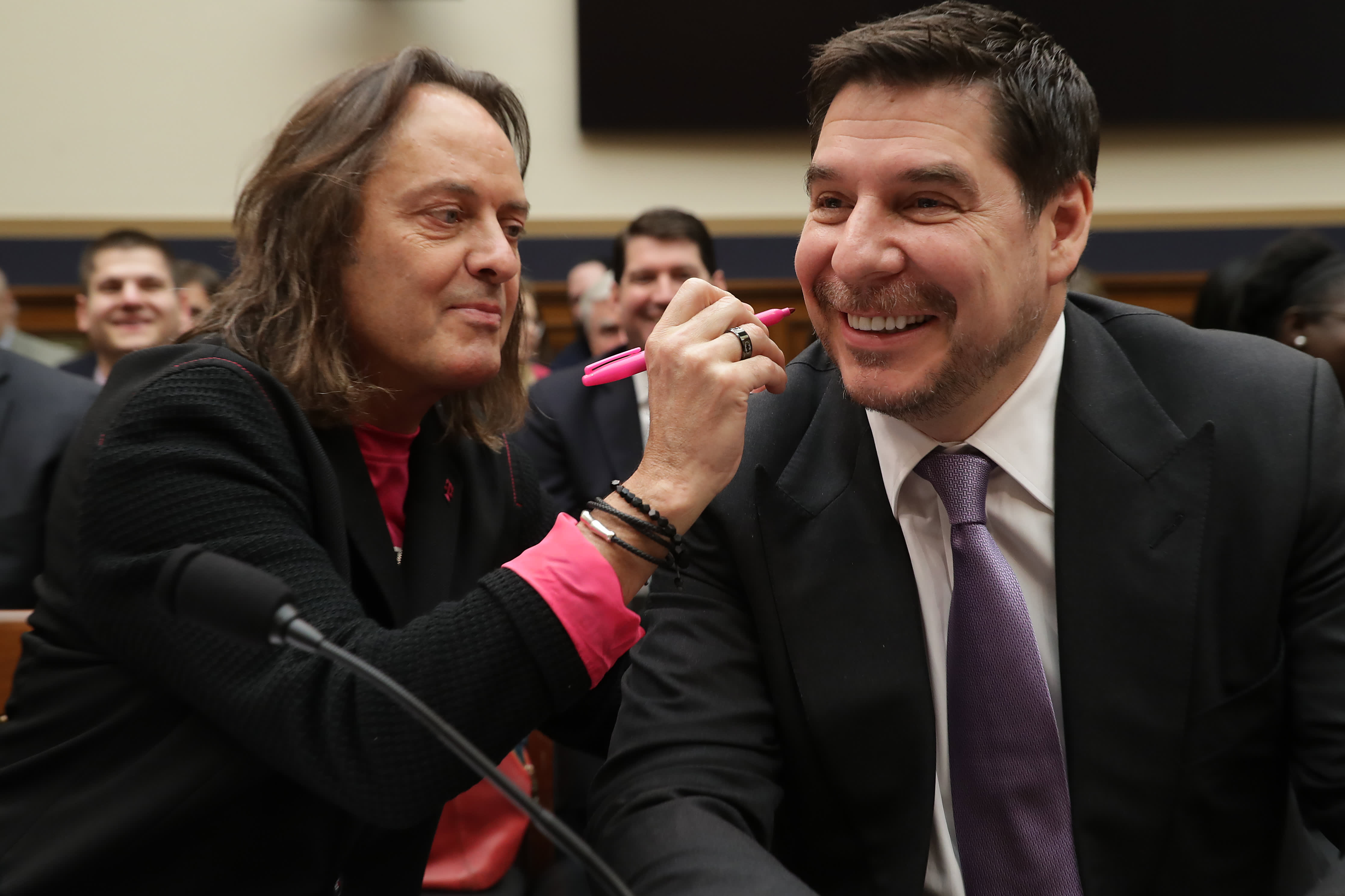 WeWork's chairman once called John Legere a 'con artist' — now they may be running WeWork together