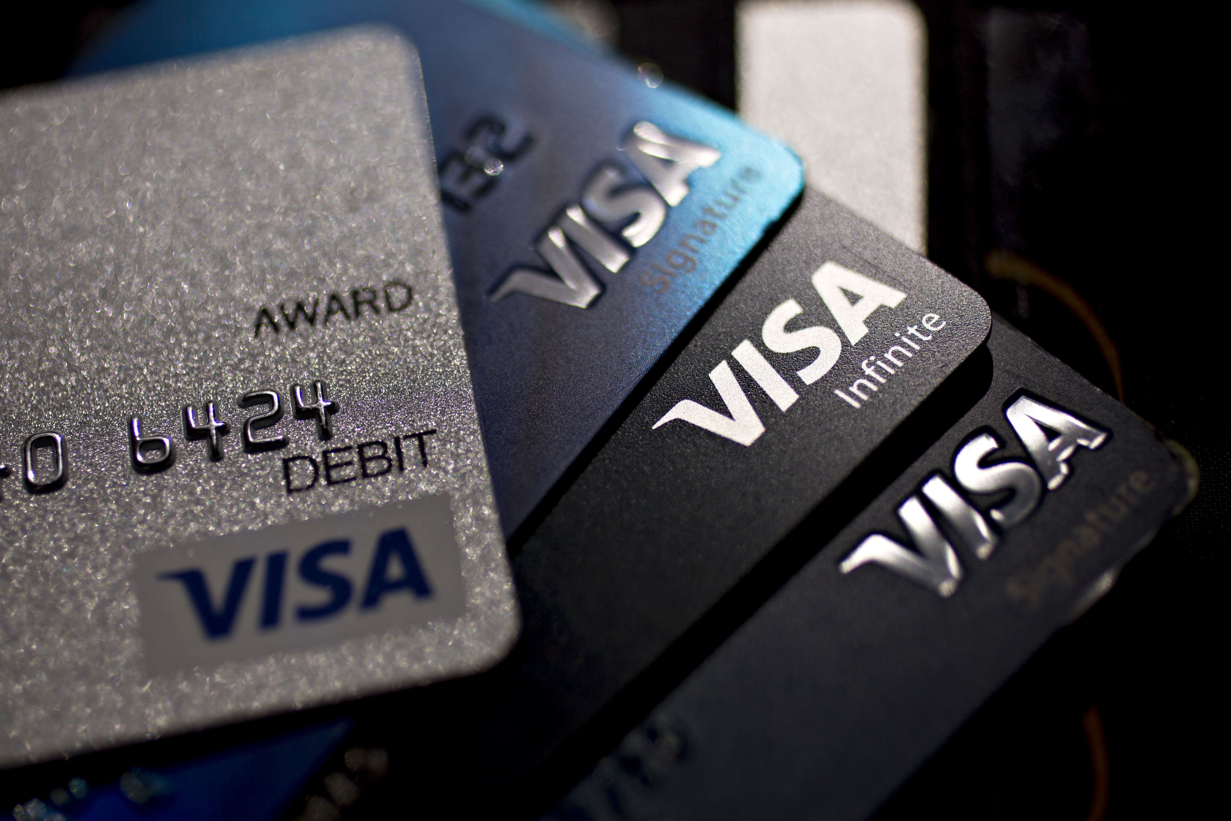 As merchants complain of Visa's high swipe fees, experts weigh in on the company's role in the retail market