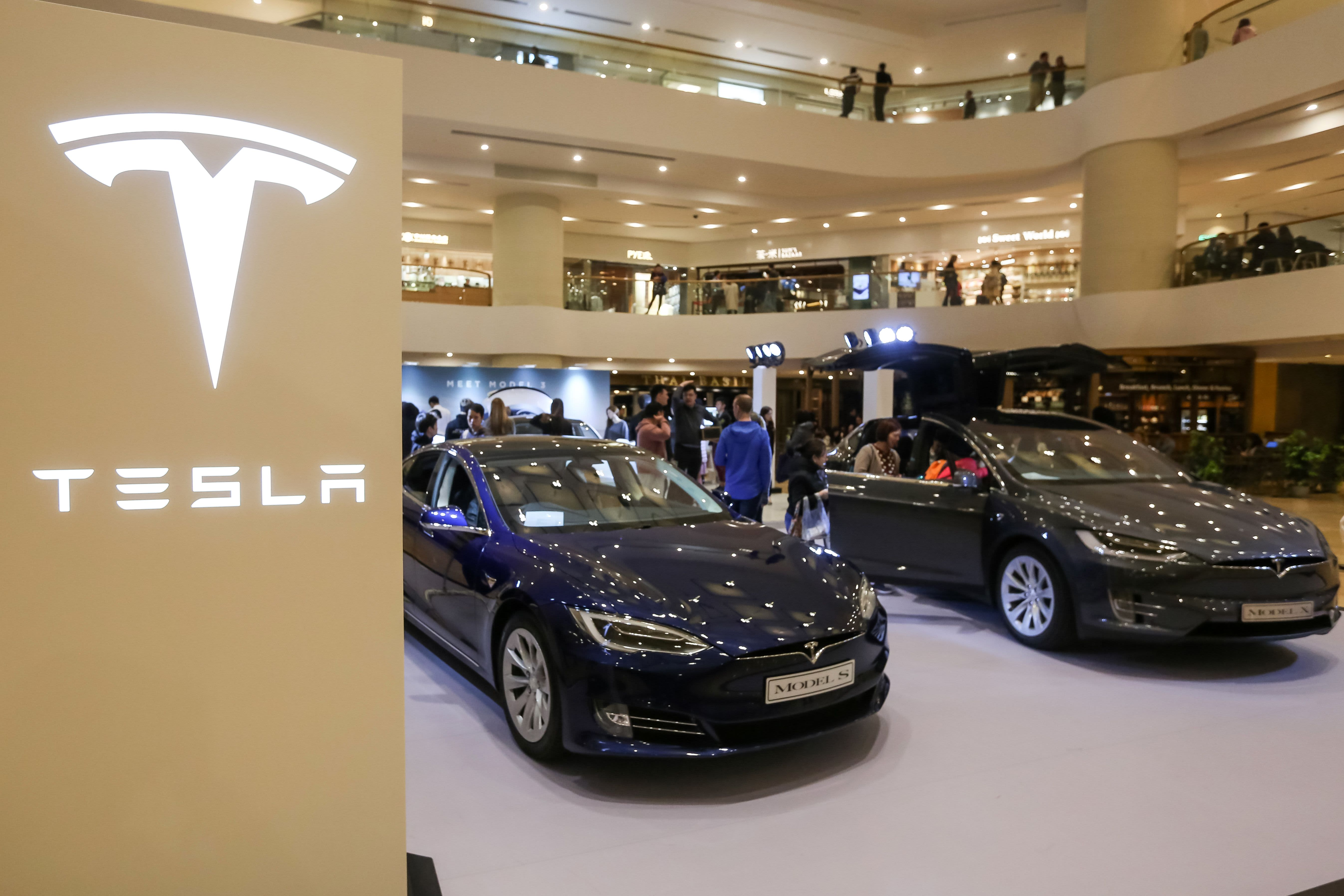 A Tesla Model S (L) and Model X are displayed at a shopping mall in Hong Kong on March 10, 2019.