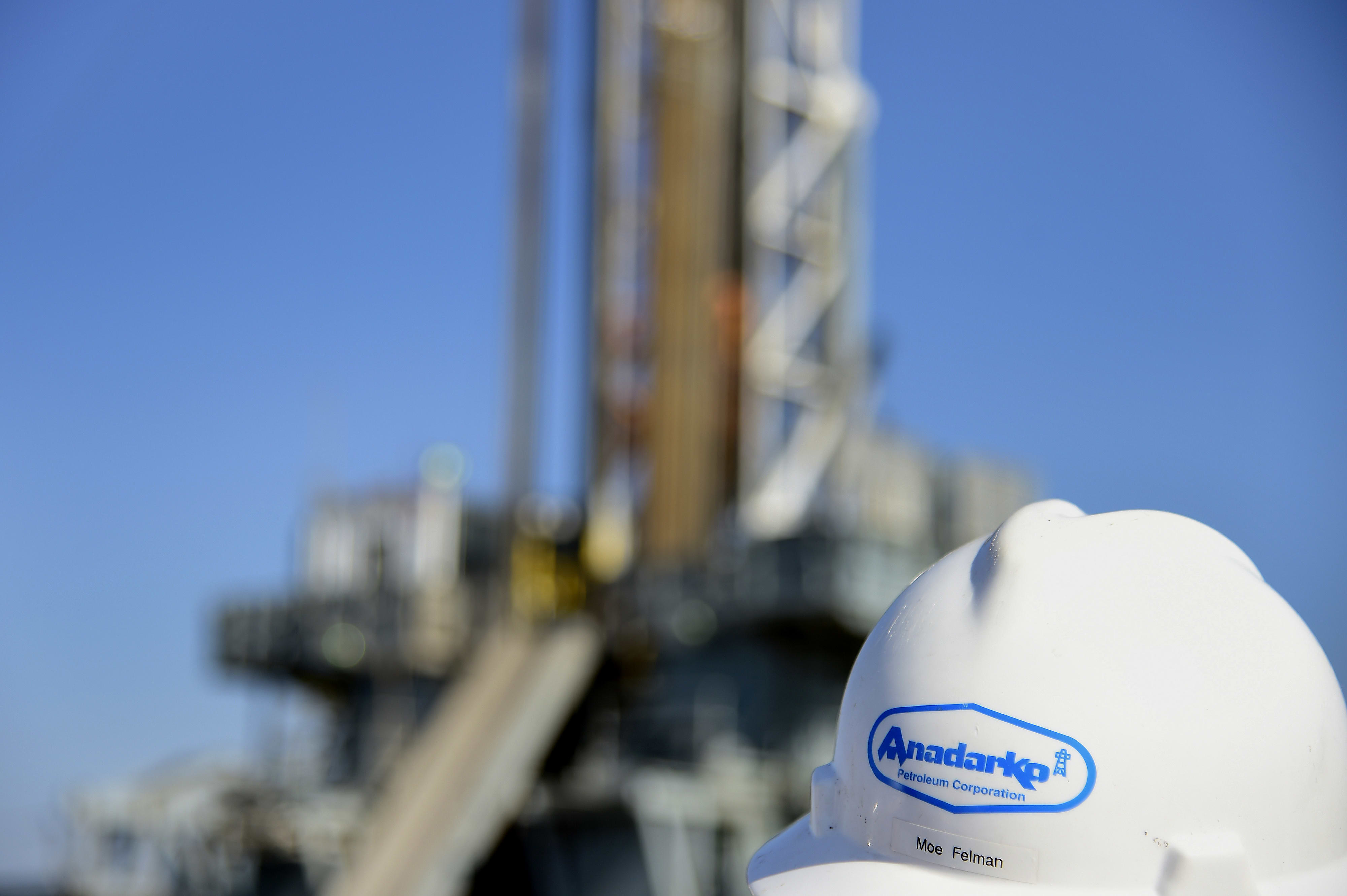 The Anadarko Petroleum Corp. logo is seen on the hard hat of a contractor at the company's oil rig site in Fort Lupton, Colorado.