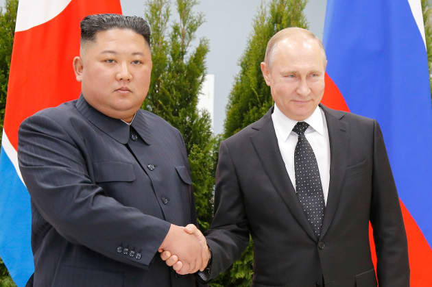 img Putin shakes hands with North Korea Kim Jong-Un