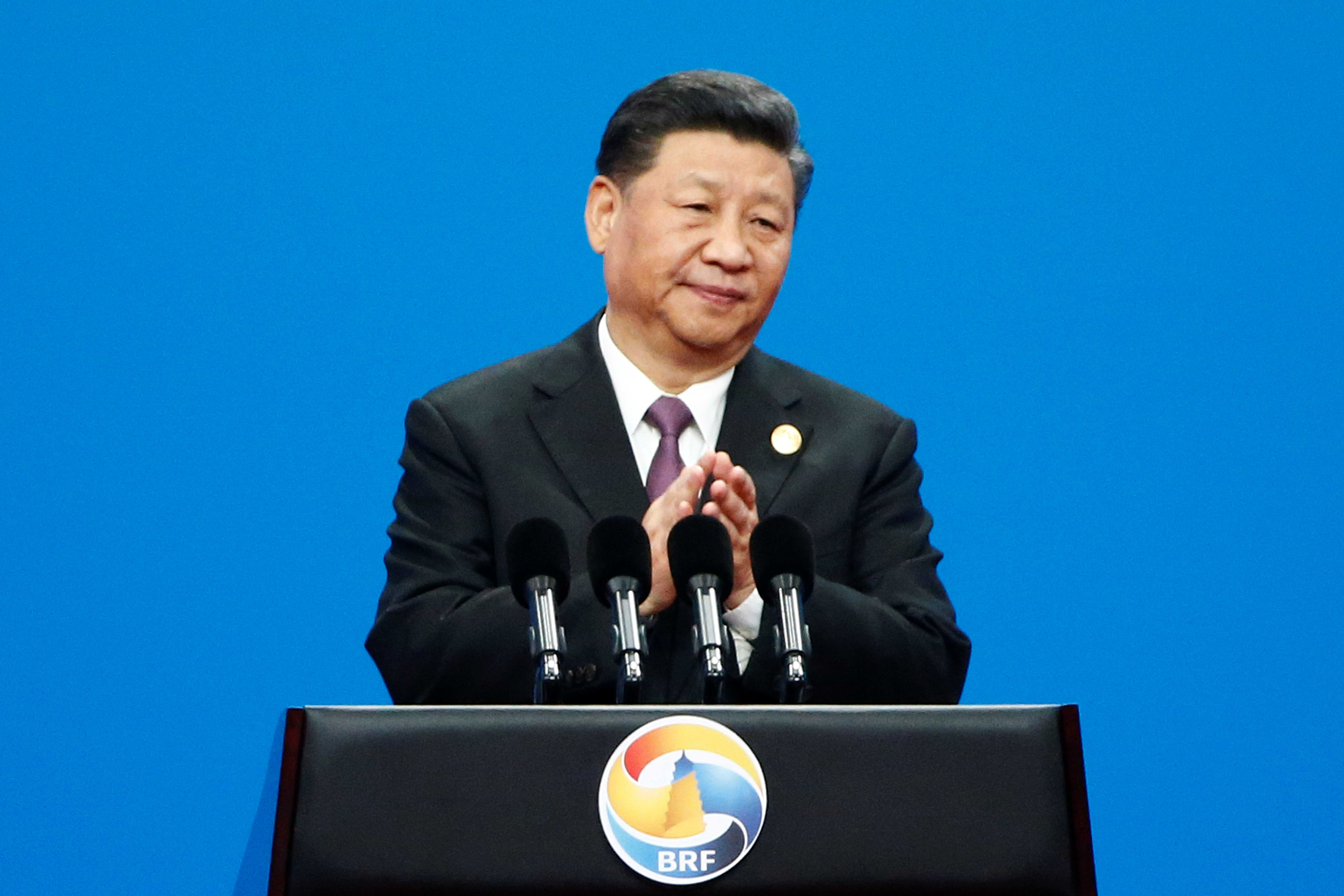 Xi tells world leaders he's committed to reforming China, but provides few details