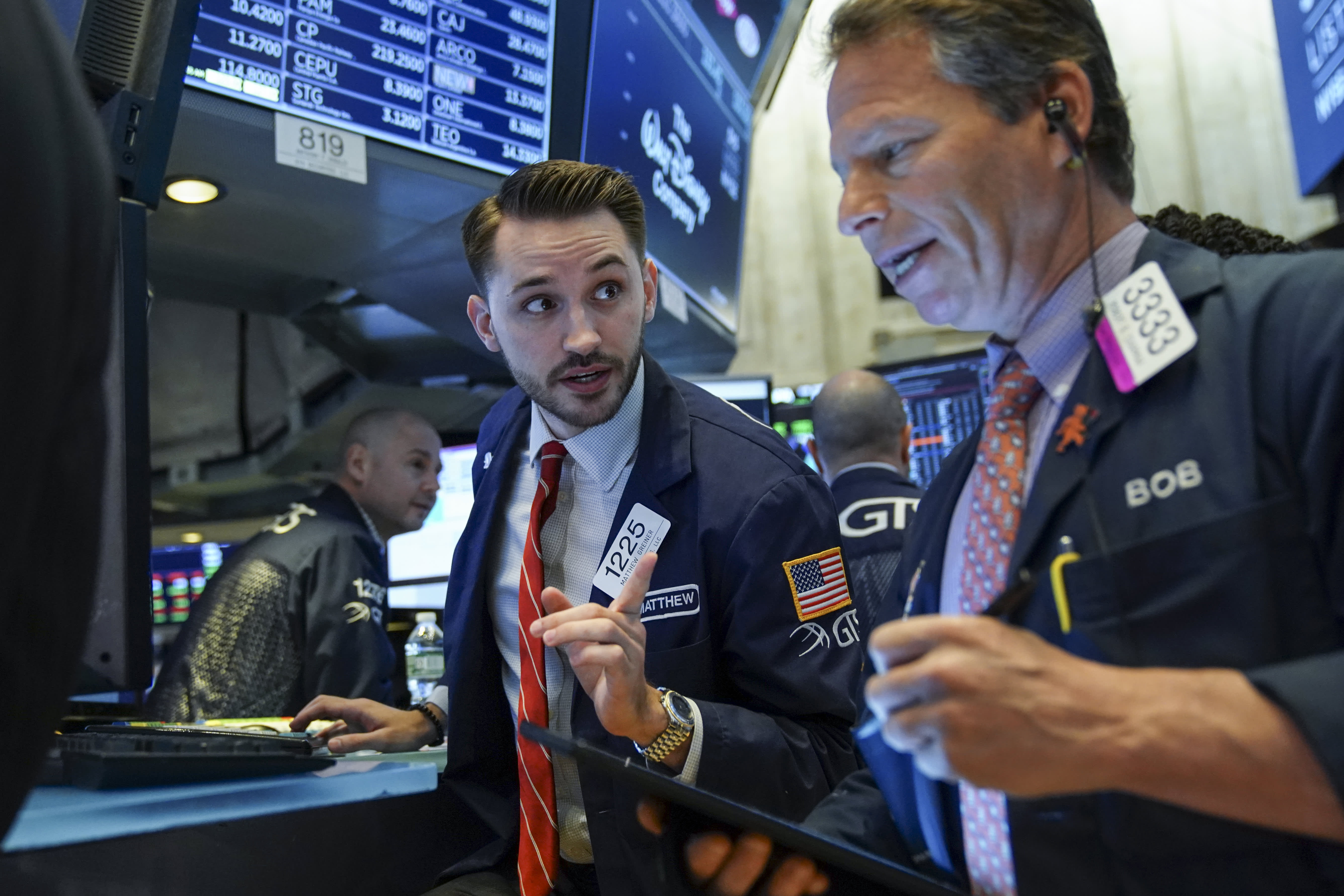 Traders and financial professionals work on the floor of the New York Stock Exchange (NYSE) at the opening bell, April 24, 2019 in New York City.
