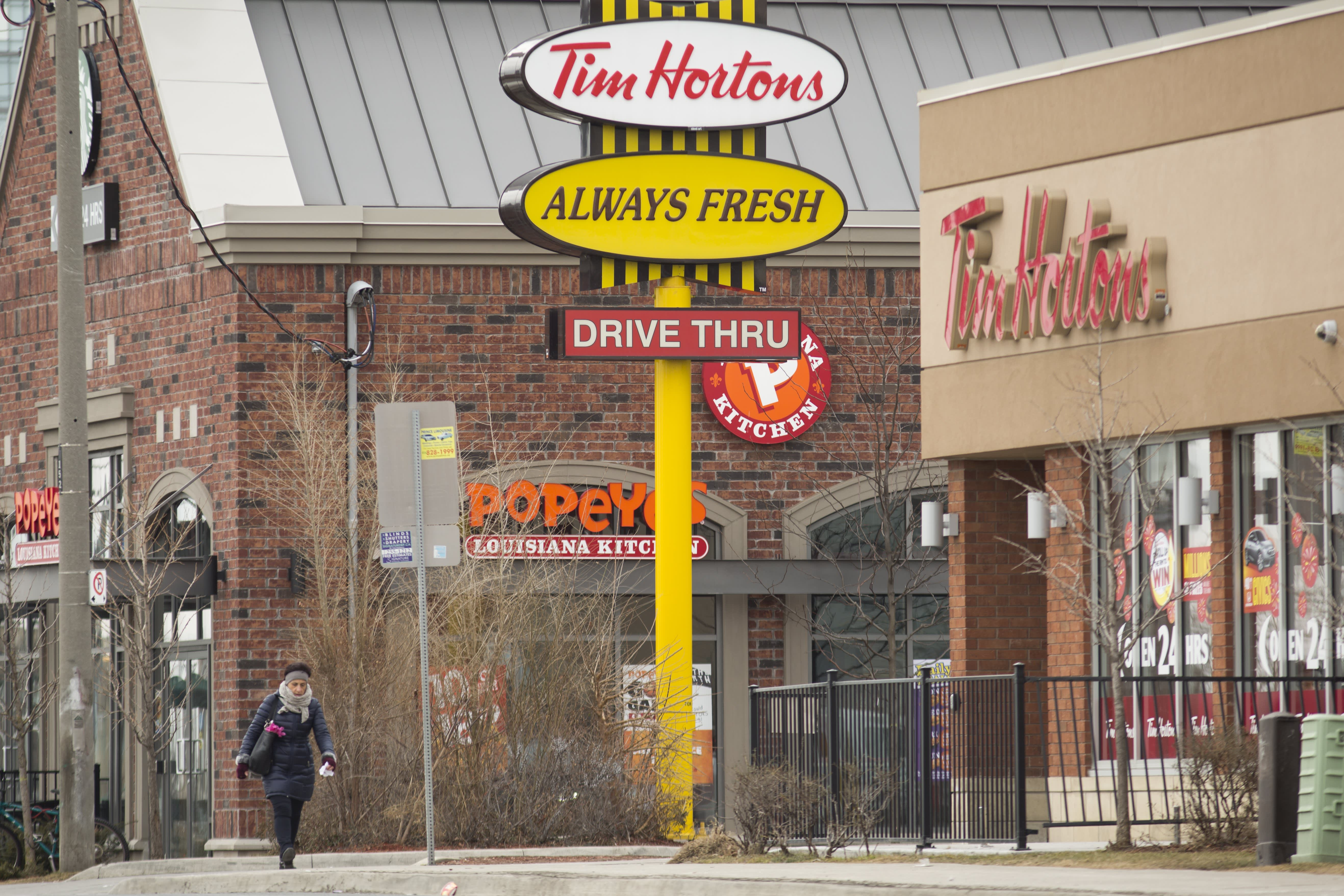 After weak third-quarter sales, Tim Hortons' parent rolls up its sleeves to fix struggling business