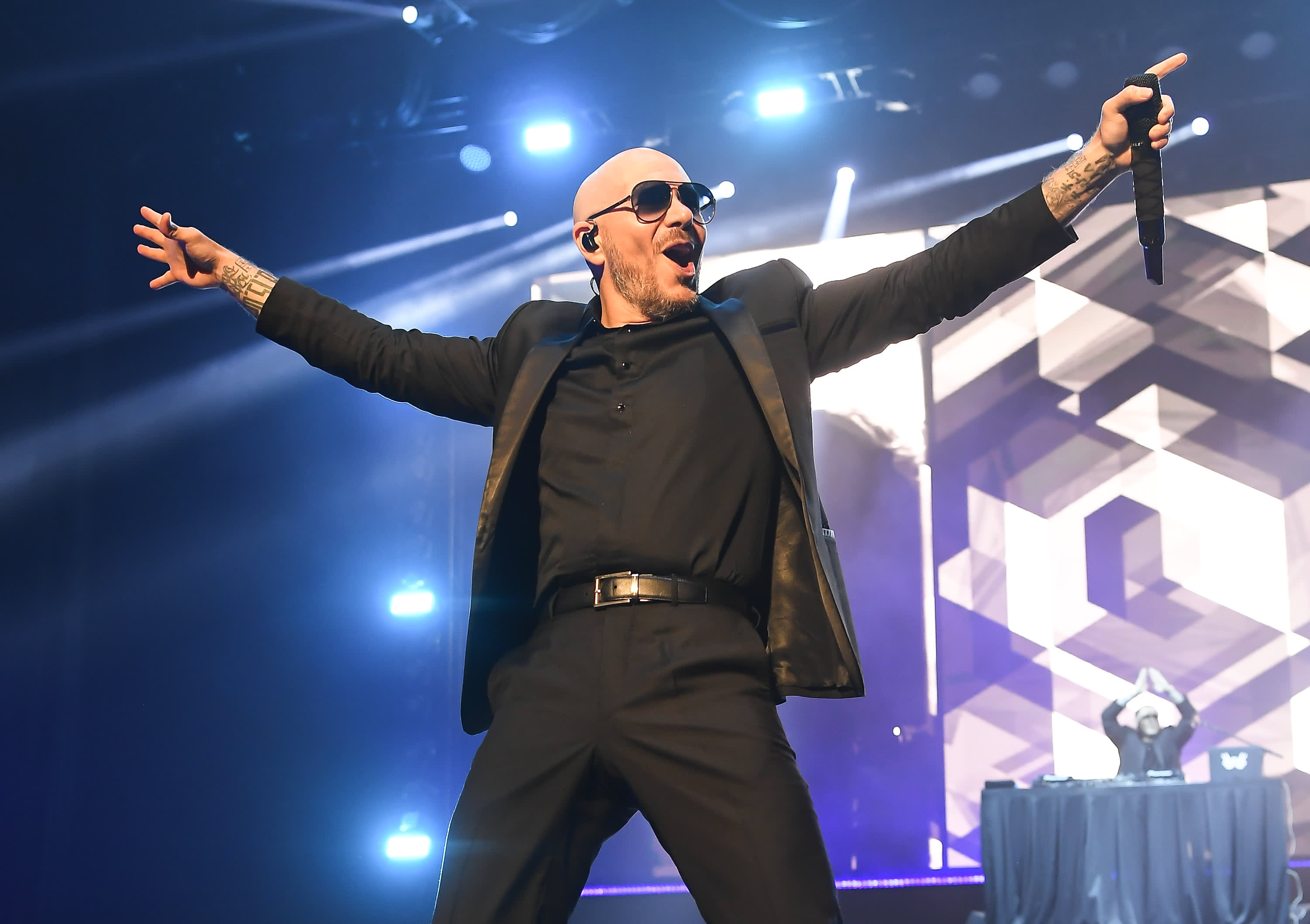 "Singer Pitbull performs at the Gavin Newson ""California Rises"" benefit concert to raise money for wildfire relief victims at Golden 1 Center on January 6, 2019 in Sacramento, California."