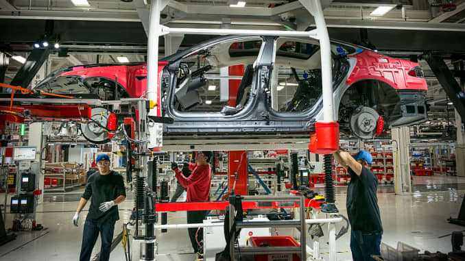 Workers assemble cars on the line at Tesla's factory in Fremont. David Butow (Photo by David Butow/Corbis via Getty Images)