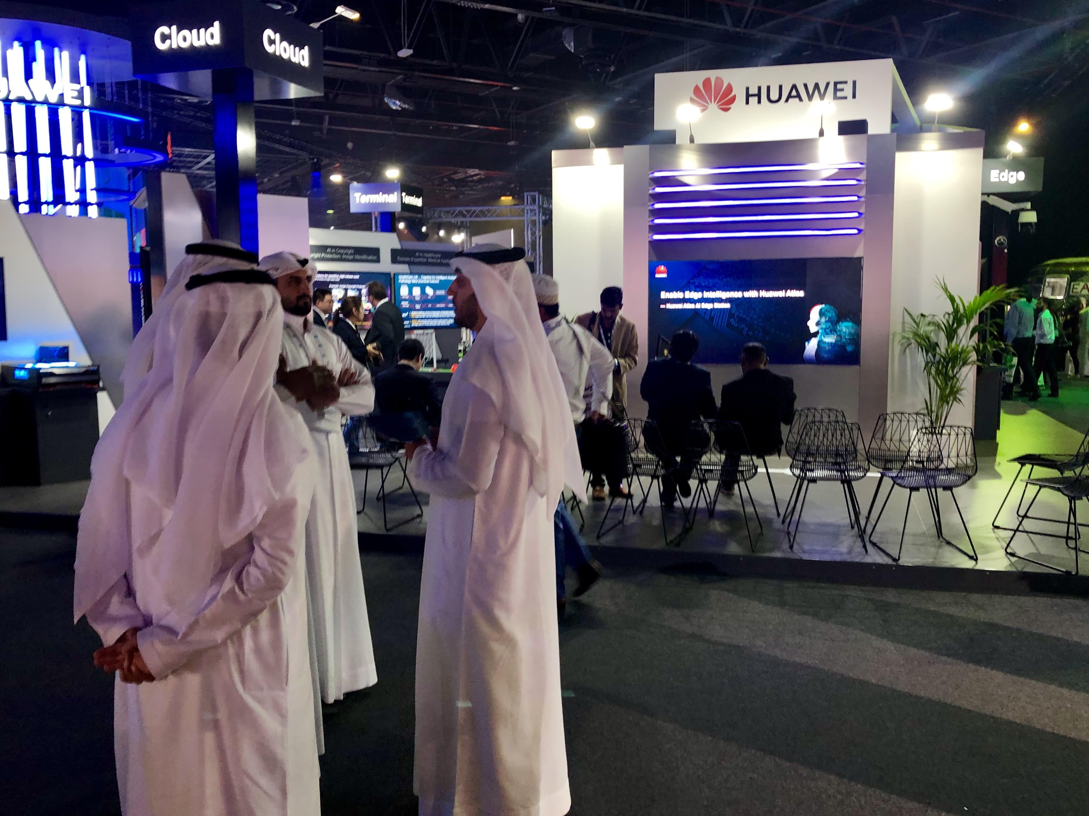 Attendees at Dubai's inaugural AI Everything summit walk among exhibitor stands. Dubai, United Arab Emirates, May 1, 2019.