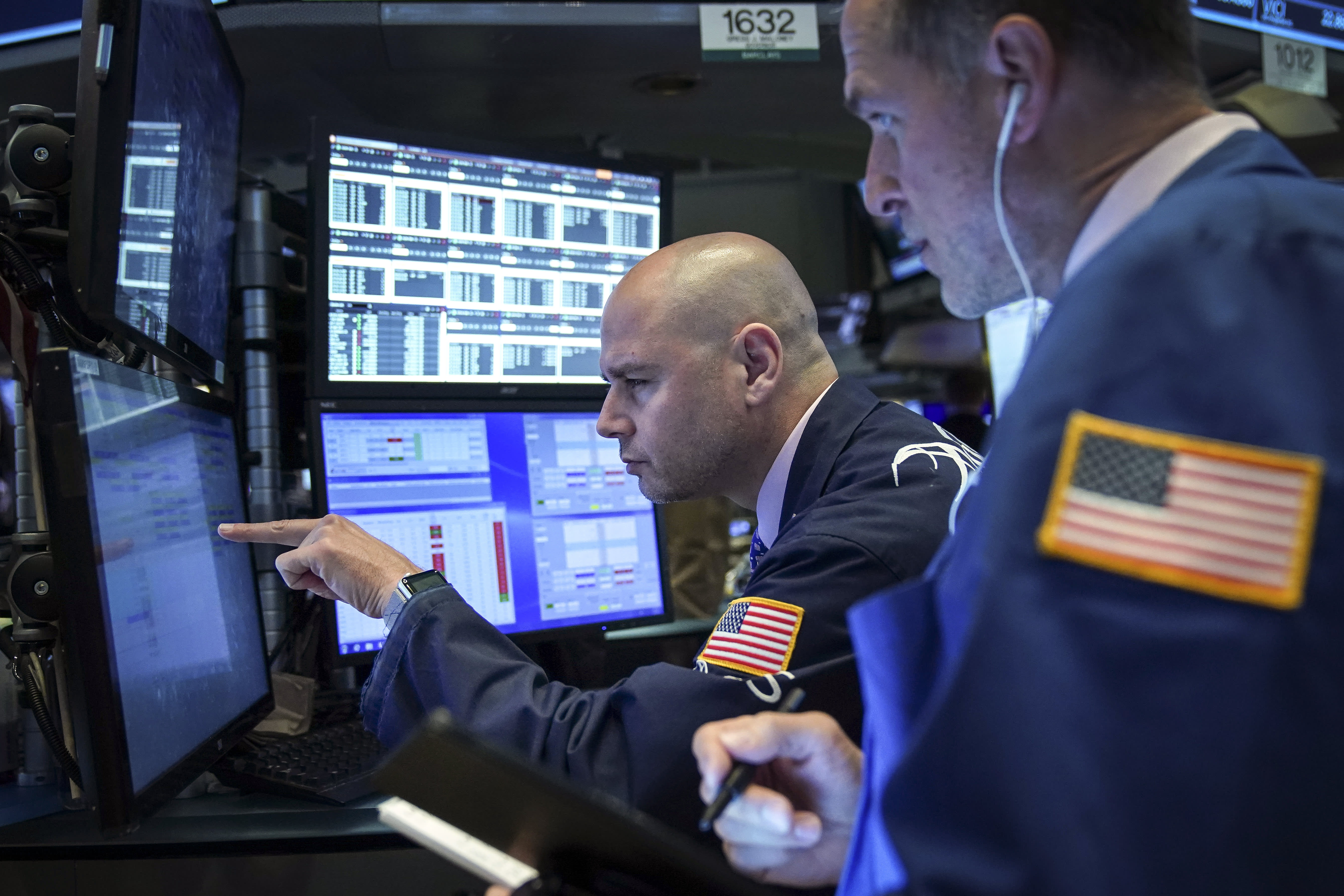 Traders and financial professionals work at the opening bell on the floor of the New York Stock Exchange (NYSE), May 6, 2019 in New York City.