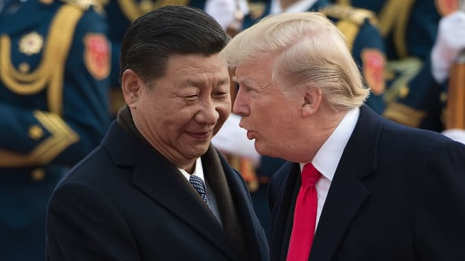 China's President Xi Jinping and U.S. President Donald Trump attend a welcome ceremony at the Great Hall of the People in Beijing on Nov. 9, 2017.