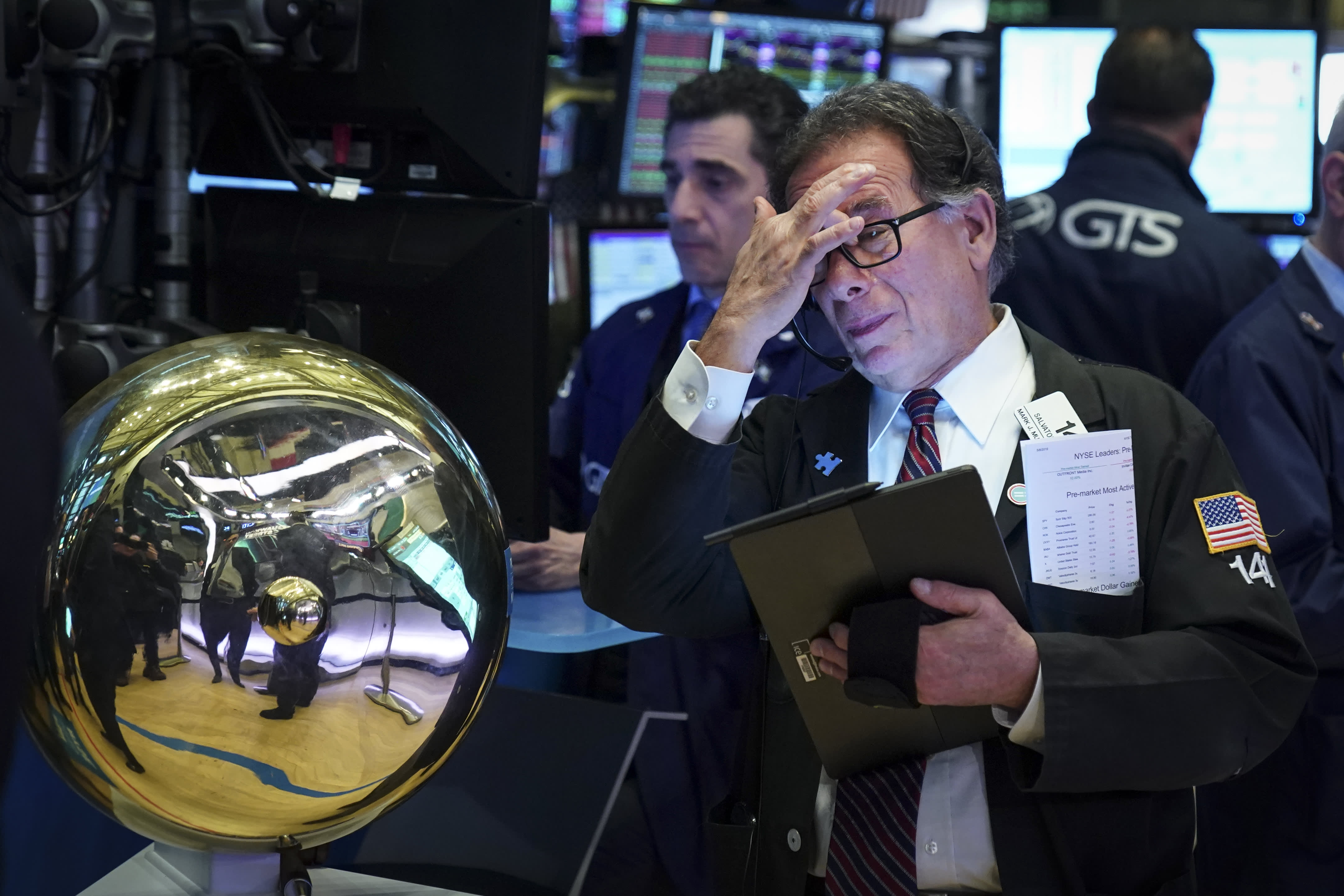 Traders and financial professionals work on the floor of the New York Stock Exchange (NYSE) ahead of the opening bell, May 8, 2019 in New York City.