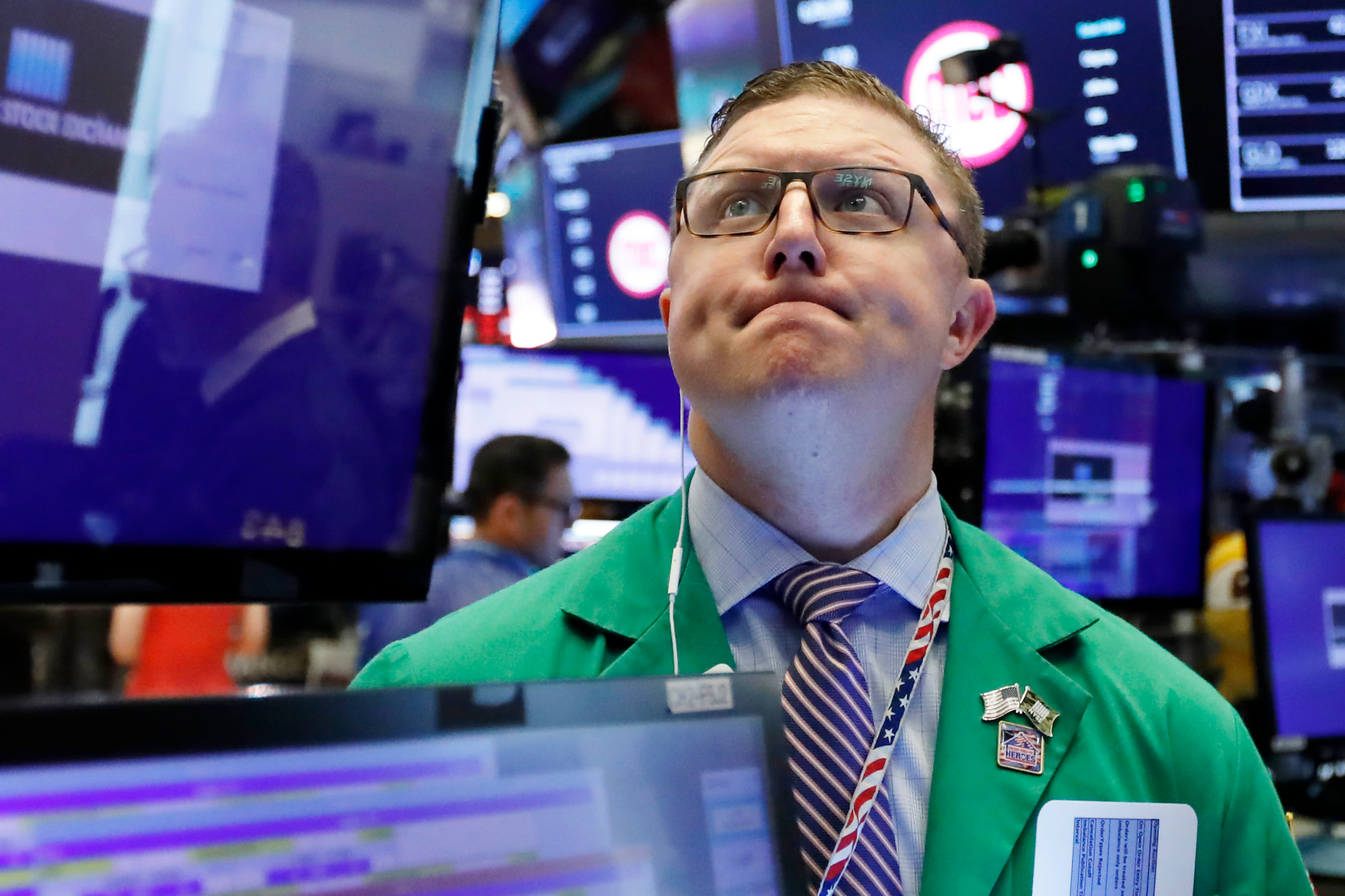 Dow drops more than 100 points on fears of a less aggressive Fed next week, Facebook falls