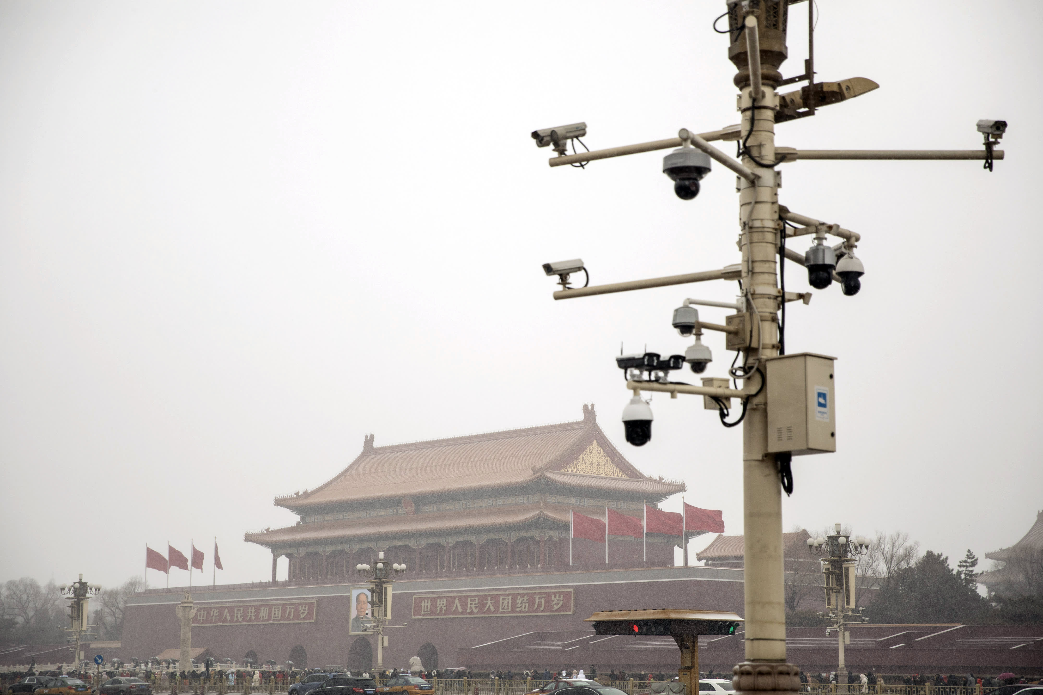 Surveillance cameras are mounted on a post at Tiananmen Square as snow falls in Beijing, China, on Thursday, Feb. 14, 2019.