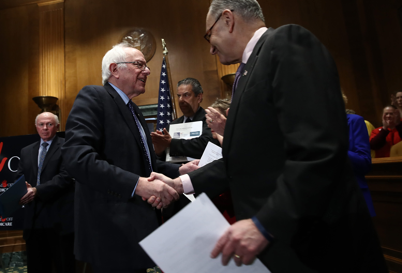 Sen. Bernie Sanders (L) (I-Vermont) and Sen. Chuck Schumer (R) (D-New York).