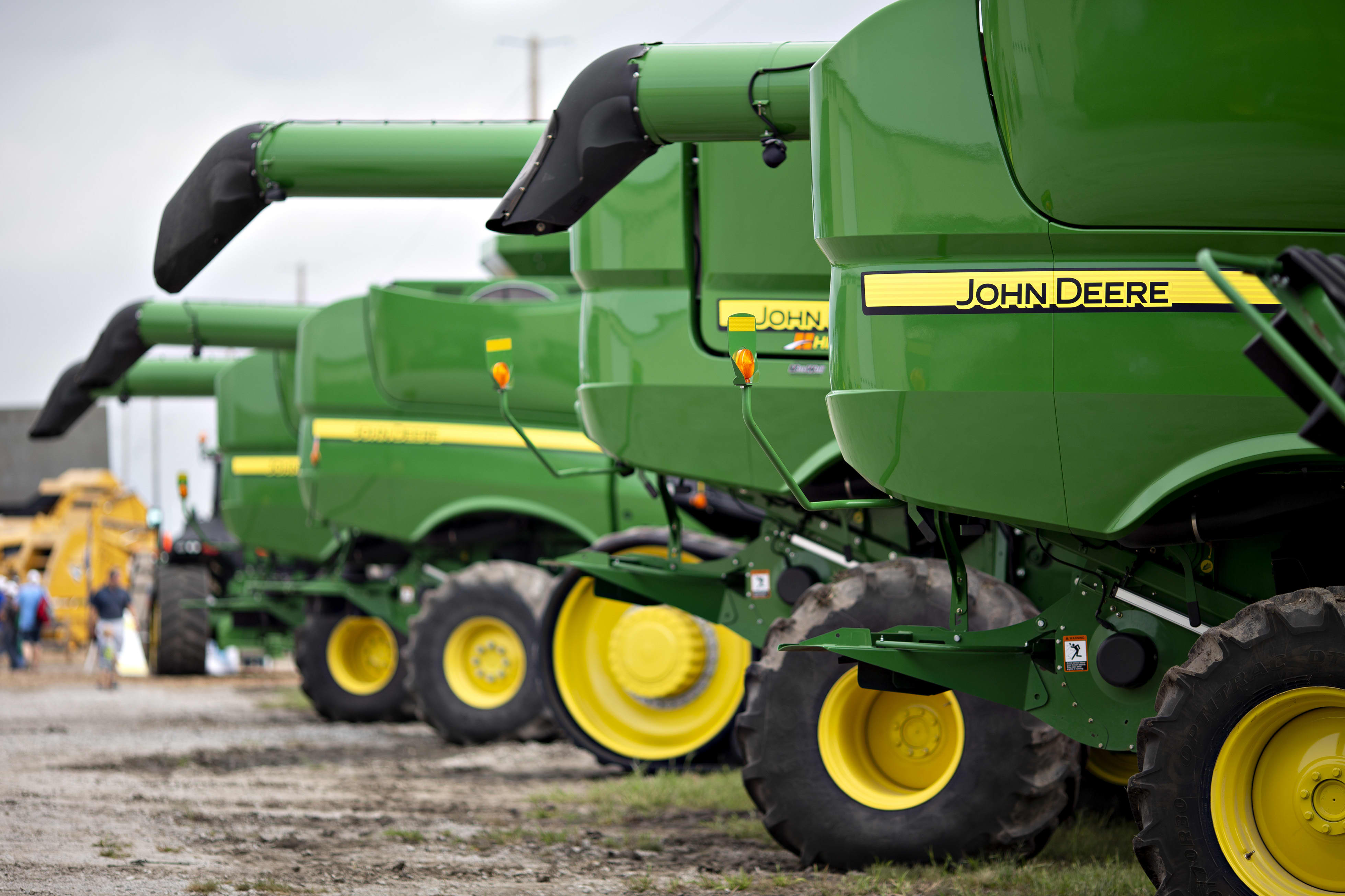 Deere earnings fall short as company says farmers are delaying purchases because of the trade war