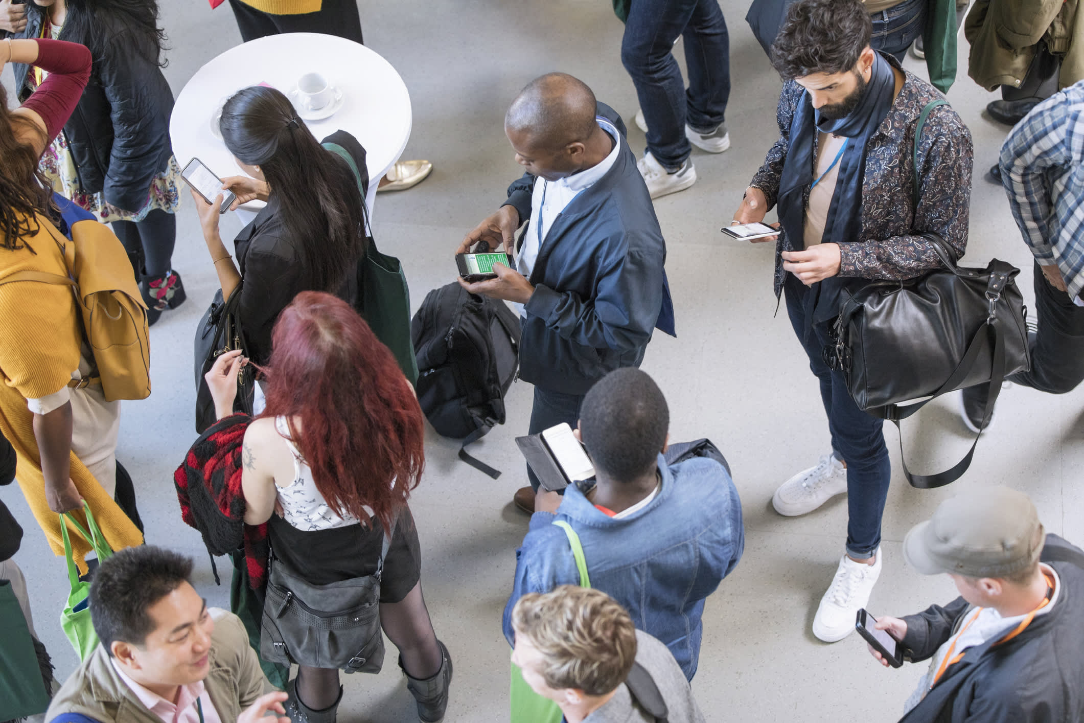 Business people using smart phones at conference