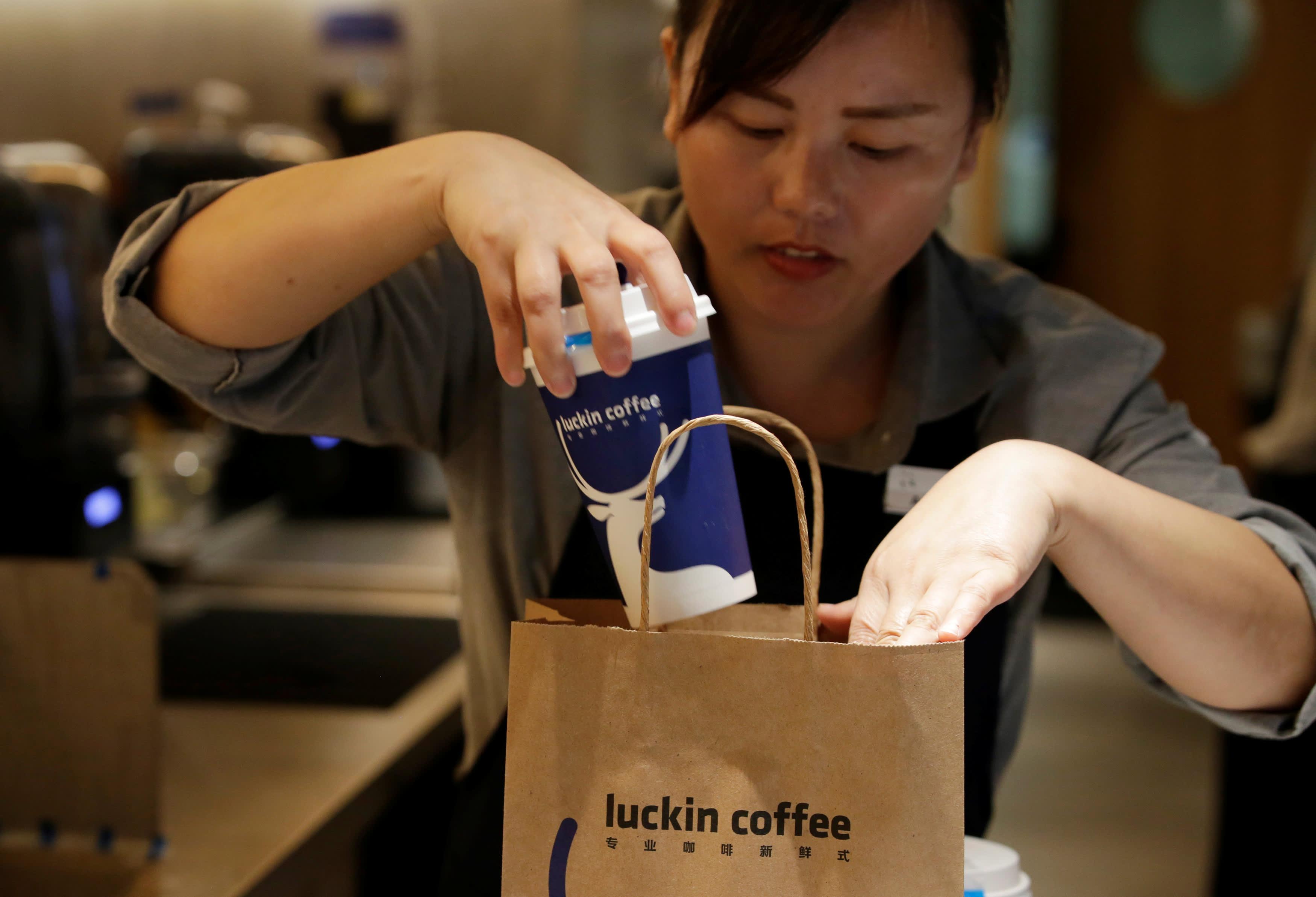 Starbucks' China challenger Luckin Coffee shares fall below IPO price
