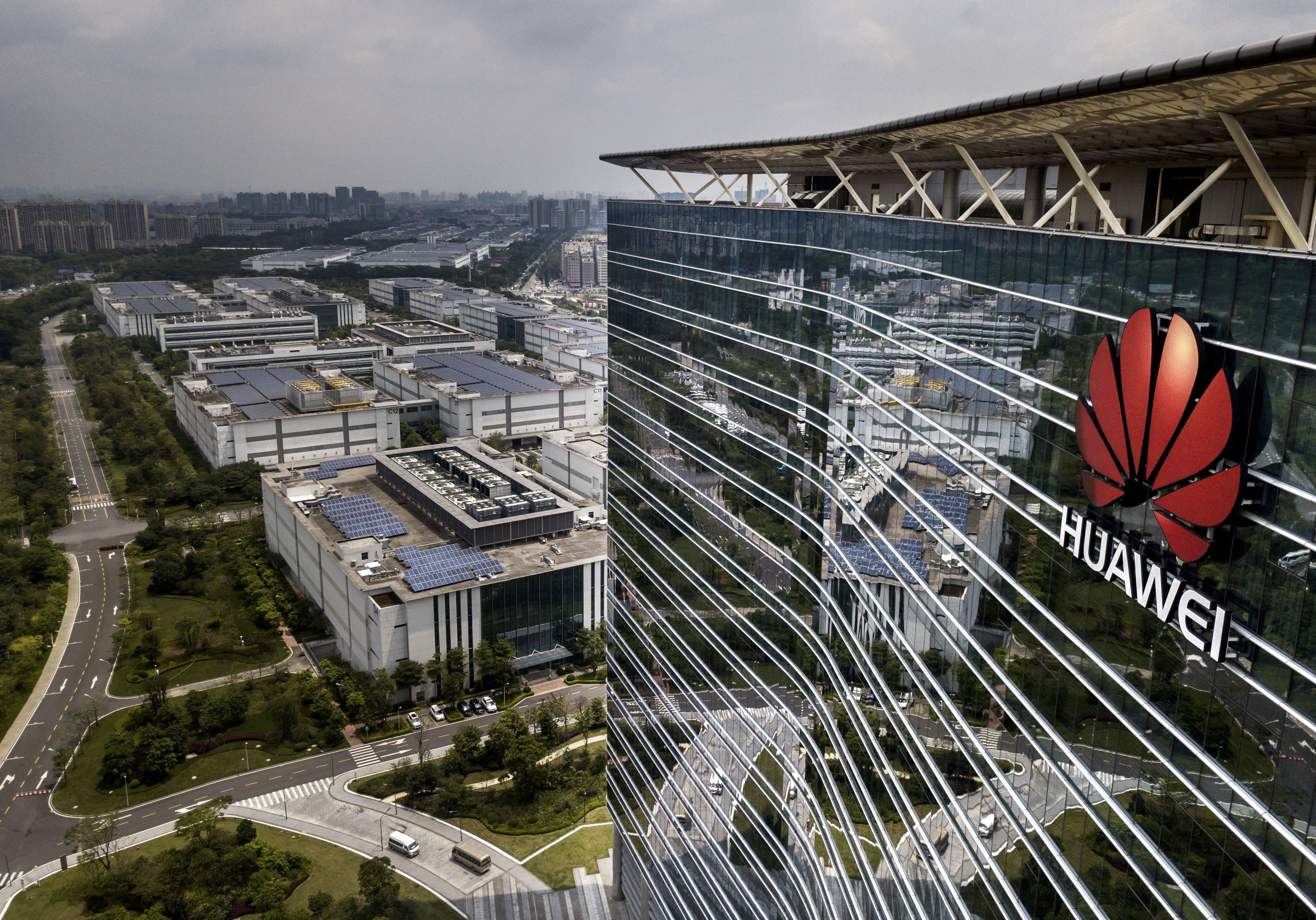 The Huawei logo is seen on the side of the main building at the company's production campus on April 25, 2019 in Dongguan, near Shenzhen, China.