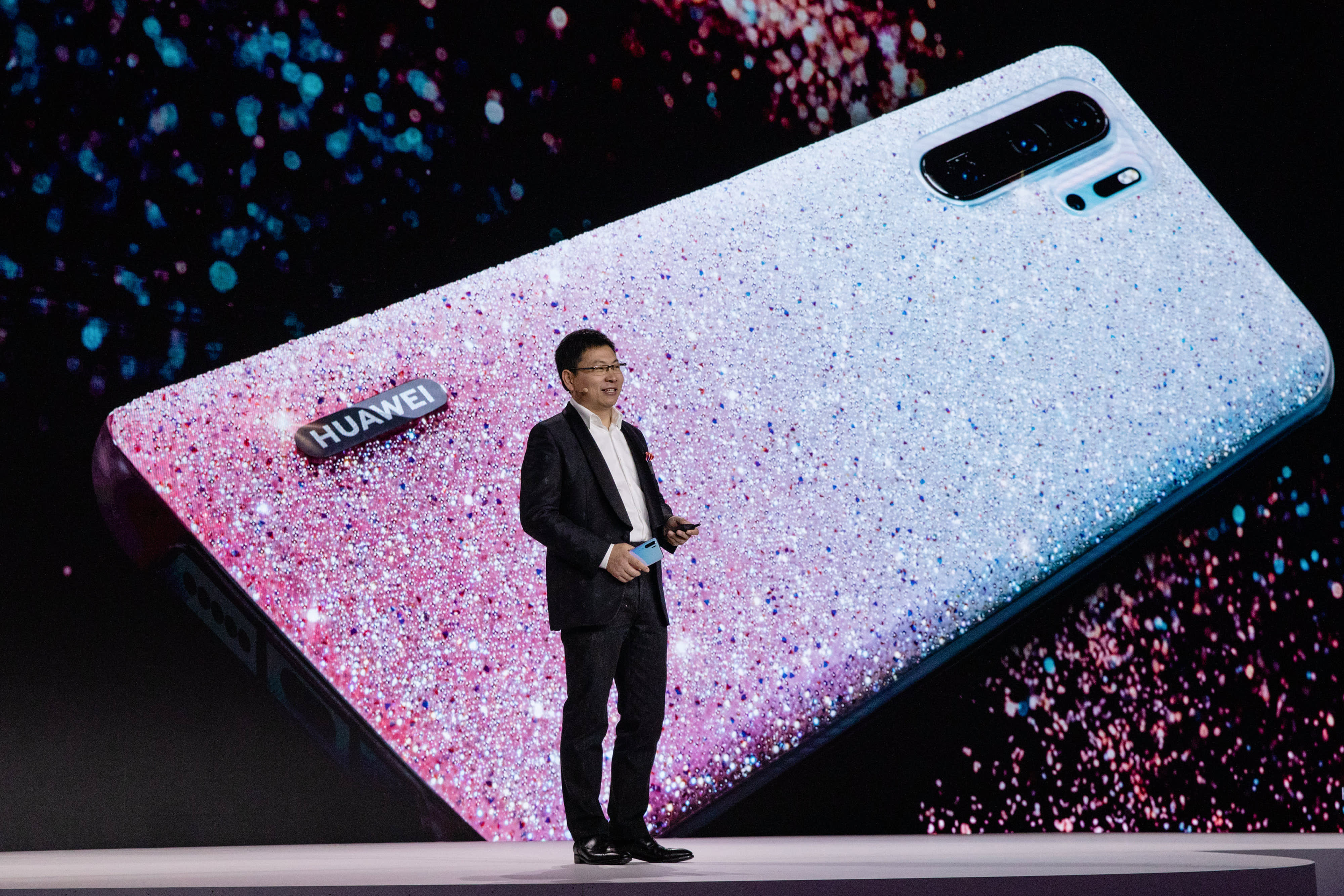 Richard Yu, chief executive officer of Huawei Technologies Co., presents the P30 series smartphone during a Huawei Technologies Co. launch event in Paris, France, on Tuesday, March 26, 2019.