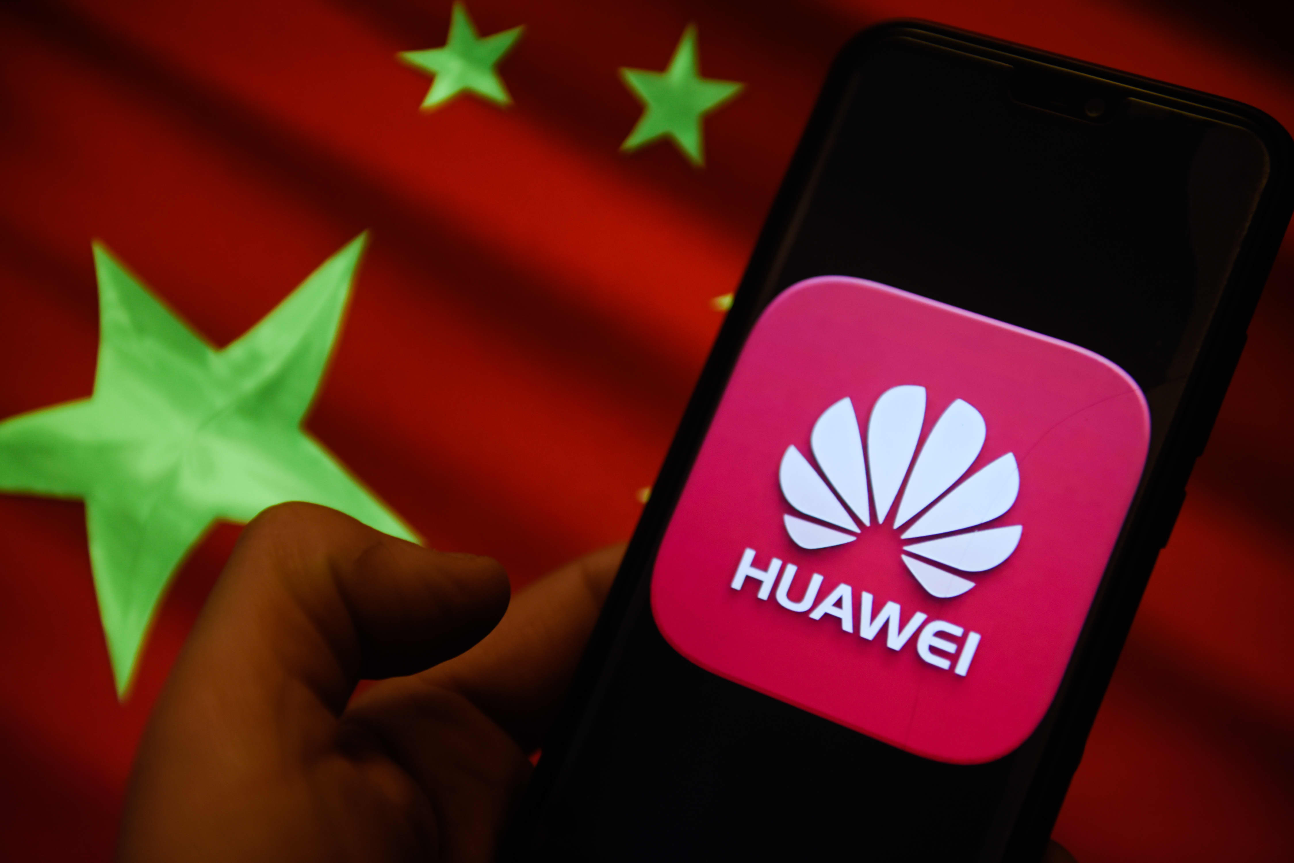 In this photo illustration, the Huawei logo and Chinese flag is seen displayed on an Android mobile phone.