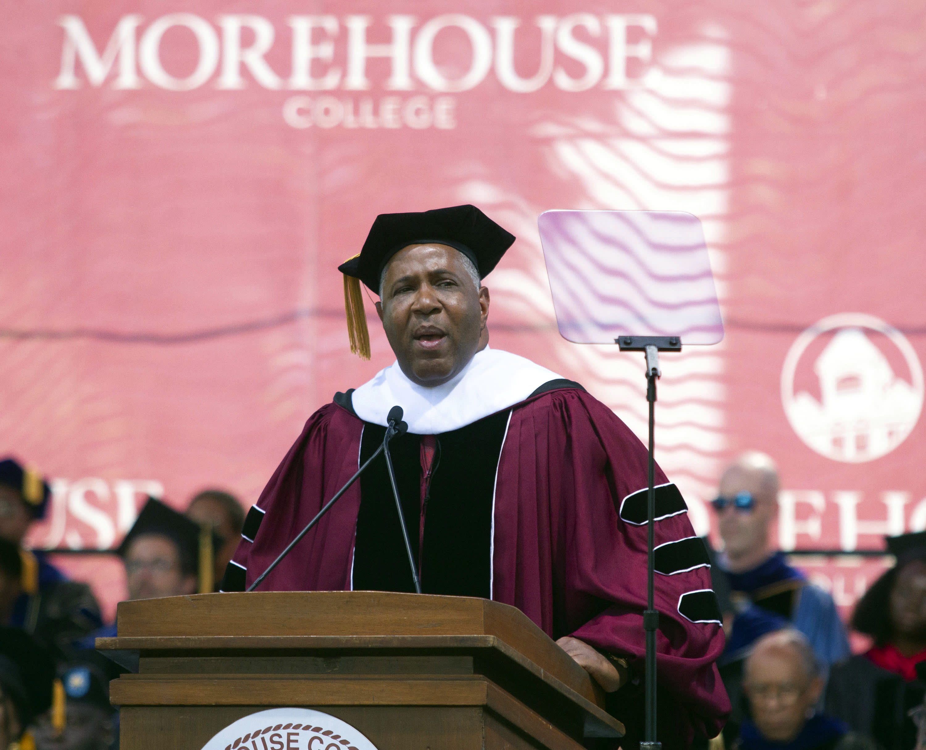 Billionaire technology investor and philanthropist Robert F. Smith announces he will provide grants to wipe out the student debt of the entire 2019 graduating class at Morehouse College in Atlanta, Sunday, May 19, 2019.