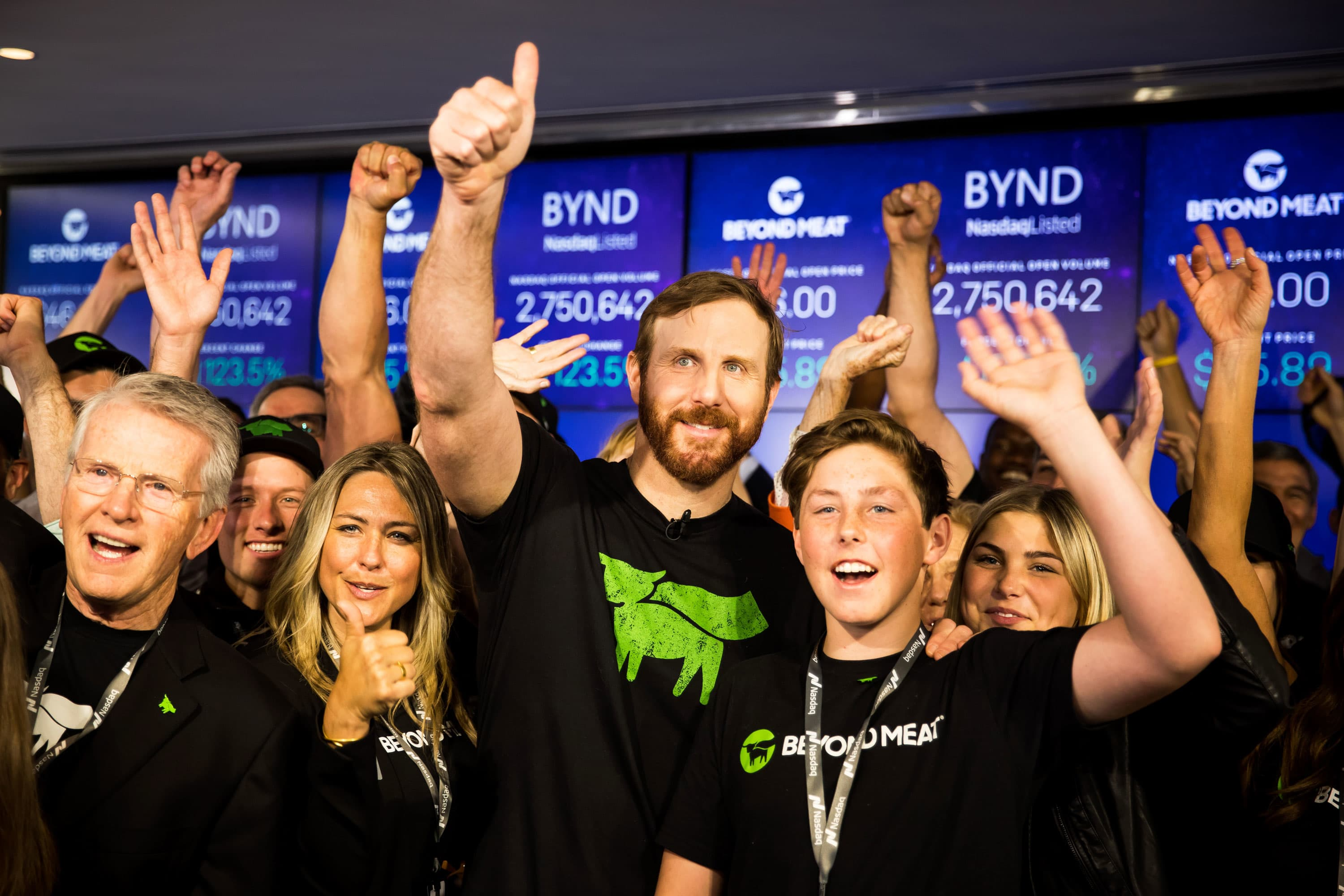 Ethan Brown, founder and chief executive officer of Beyond Meat Inc., center, celebrates with his wife Tracy Brown, center left, and guests during the company's initial public offering (IPO) at the Nasdaq MarketSite in New York, U.S., on Thursday, May 2, 2019.