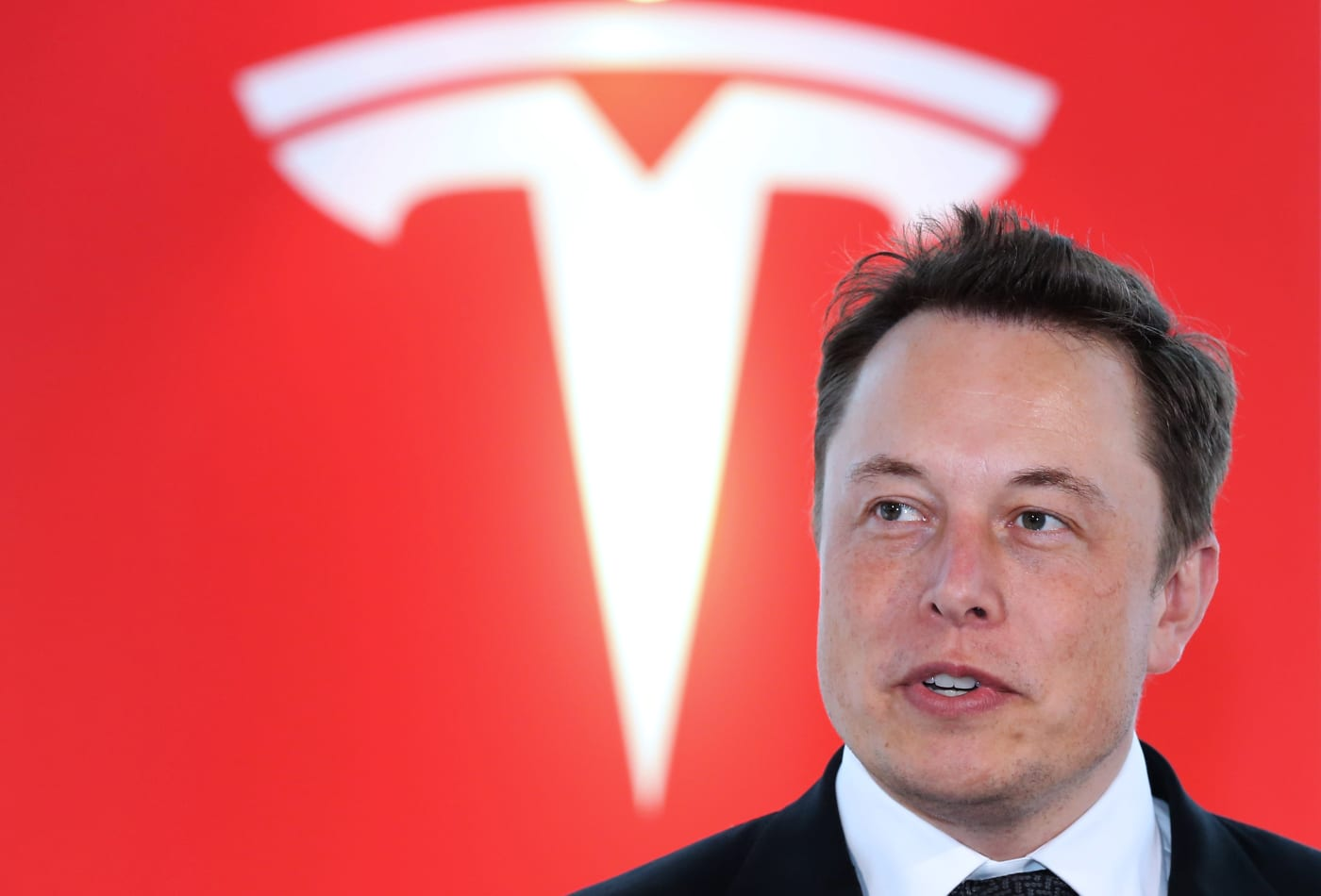 Tesla shares rise, reversing early losses following $2 billion stock offering