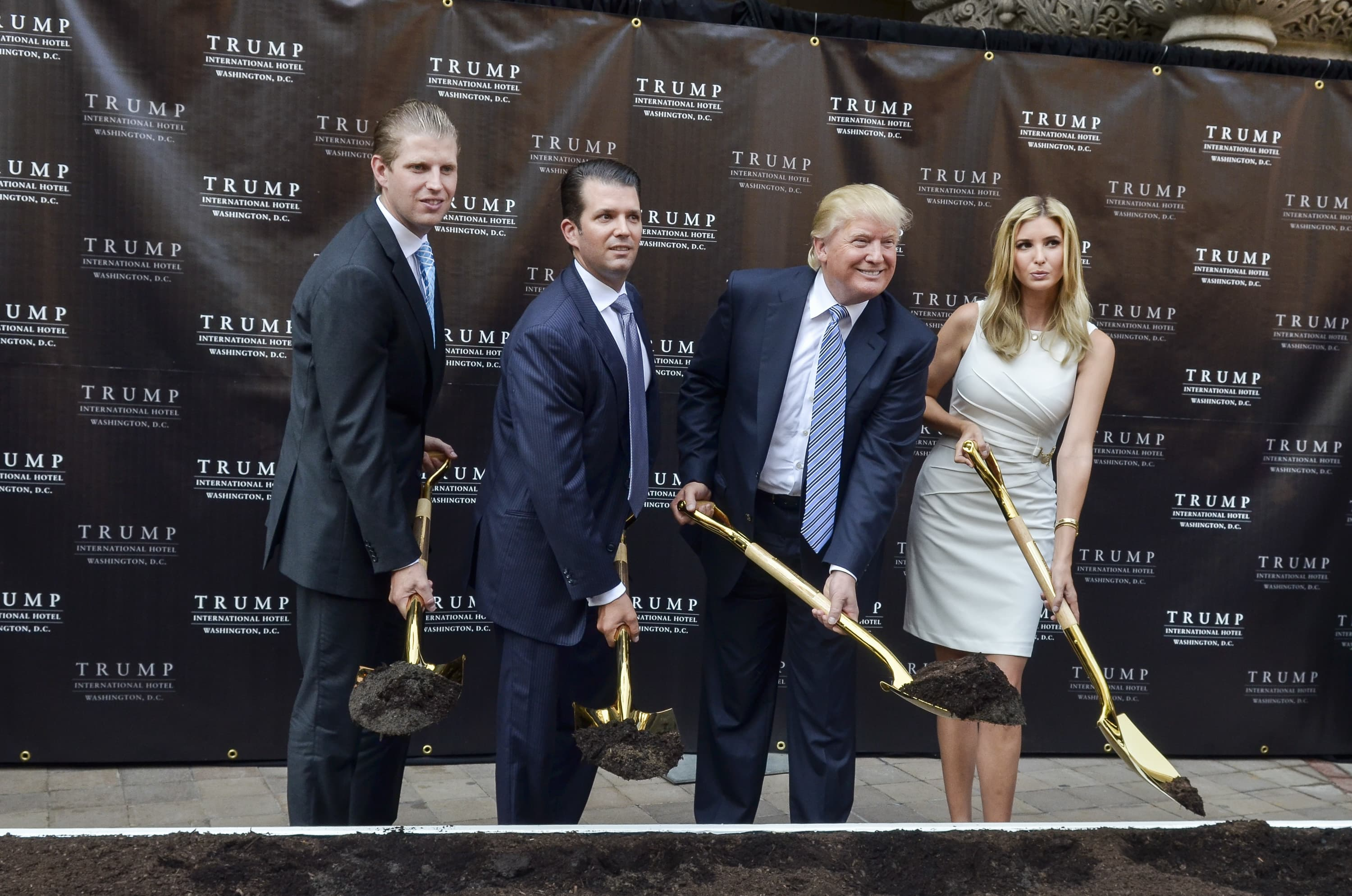 Eric Trump, Donald Trump Jr., Donald Trump and Ivanka Trump attend the Trump International Hotel Washington, D.C Groundbreaking Ceremony at Old Post Office on July 23, 2014 in Washington, DC.