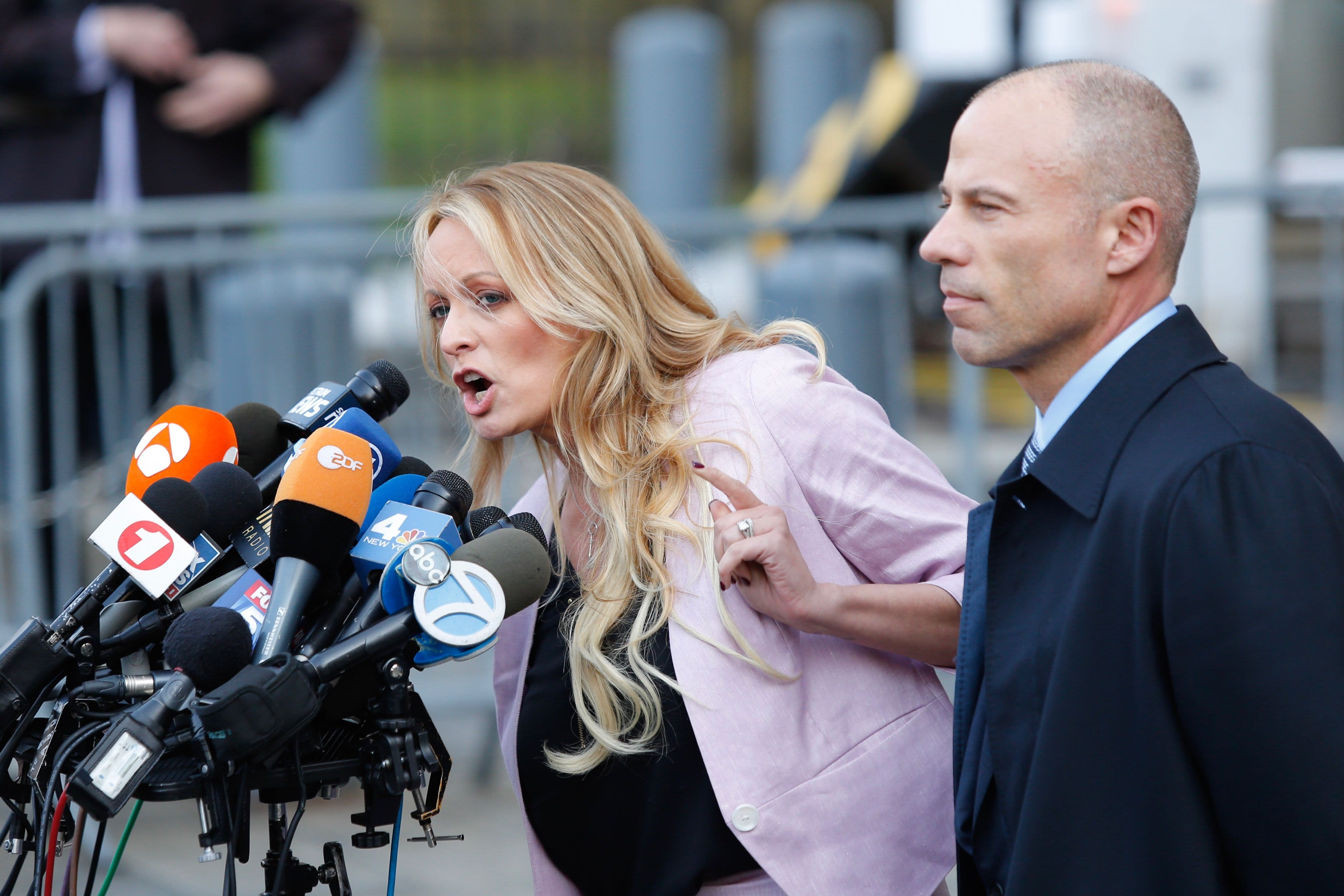 Adult-film actress Stephanie Clifford, also known as Stormy Daniels speaks US Federal Court with her lawyer Michael Avenatti (R) on April 16, 2018, in Lower Manhattan, New York.
