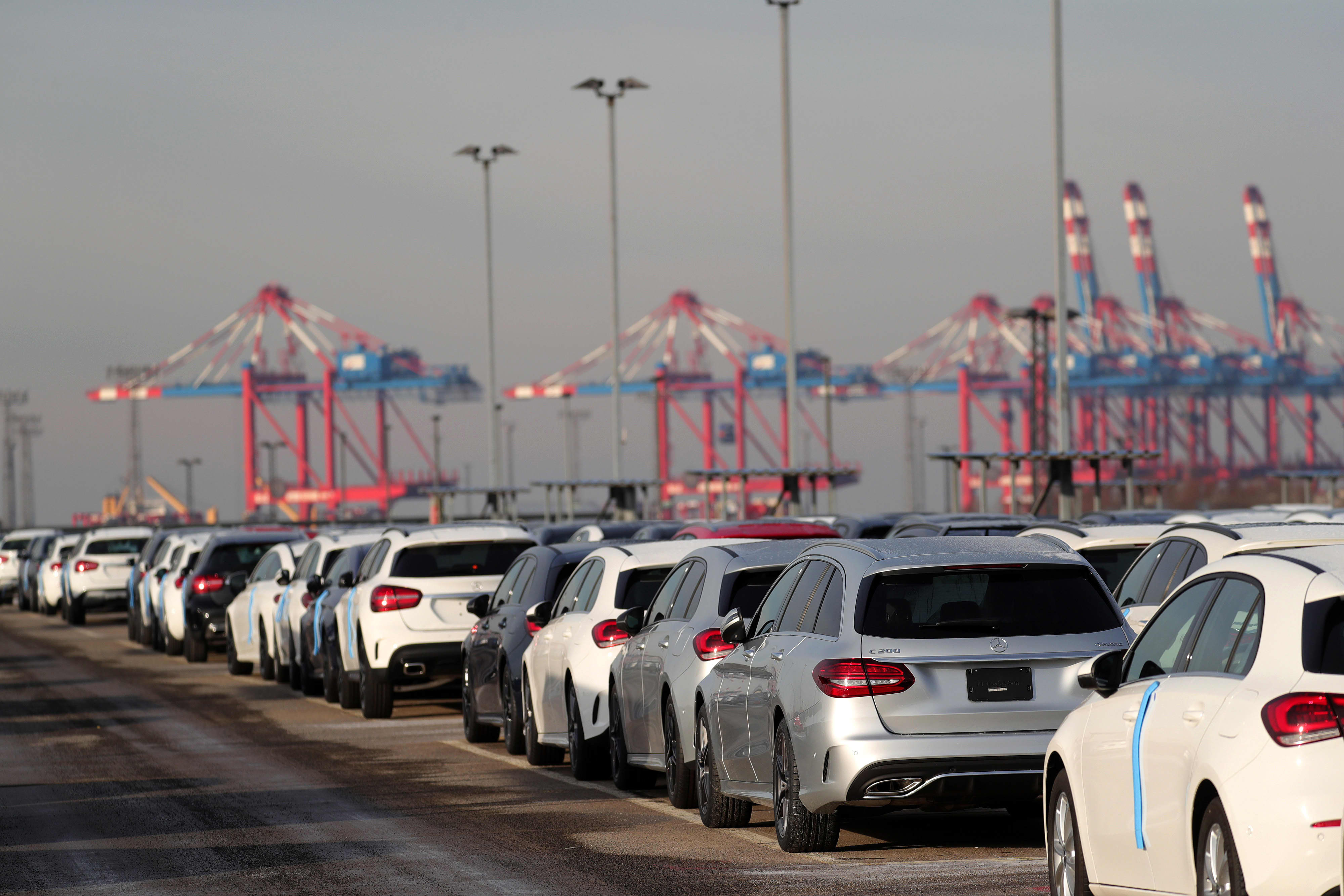 New Mercedes-Benz AG automobiles sit on the dockside ahead of export from the BLG Logistics Group AG terminal at the Port of Bremerhaven in Bremerhaven, Germany, on Tuesday, Jan. 22, 2019.