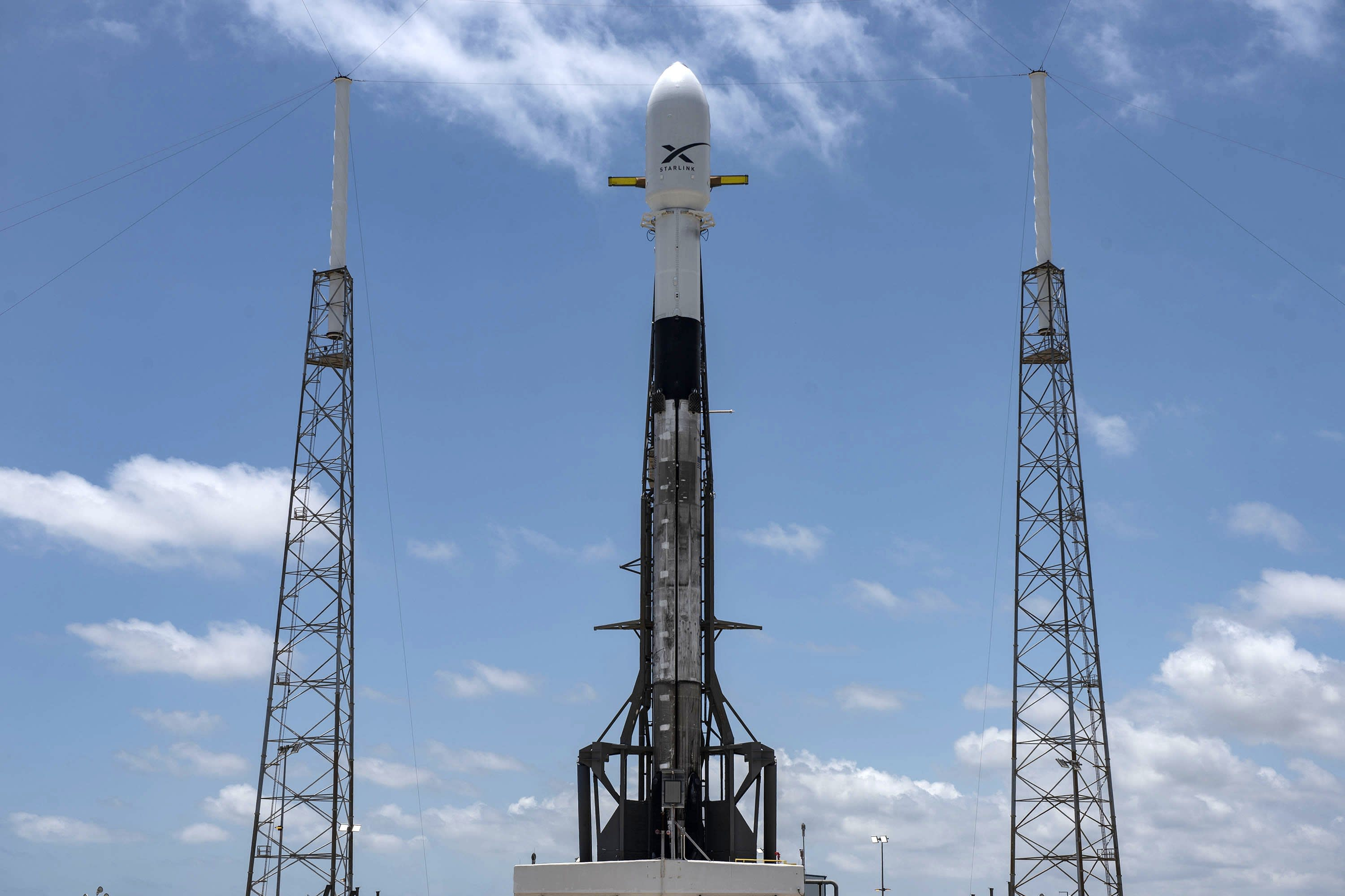 A SpaceX Falcon 9 rocket loaded with 60 Starlink satellites stands on the company's launchpad in Florida.