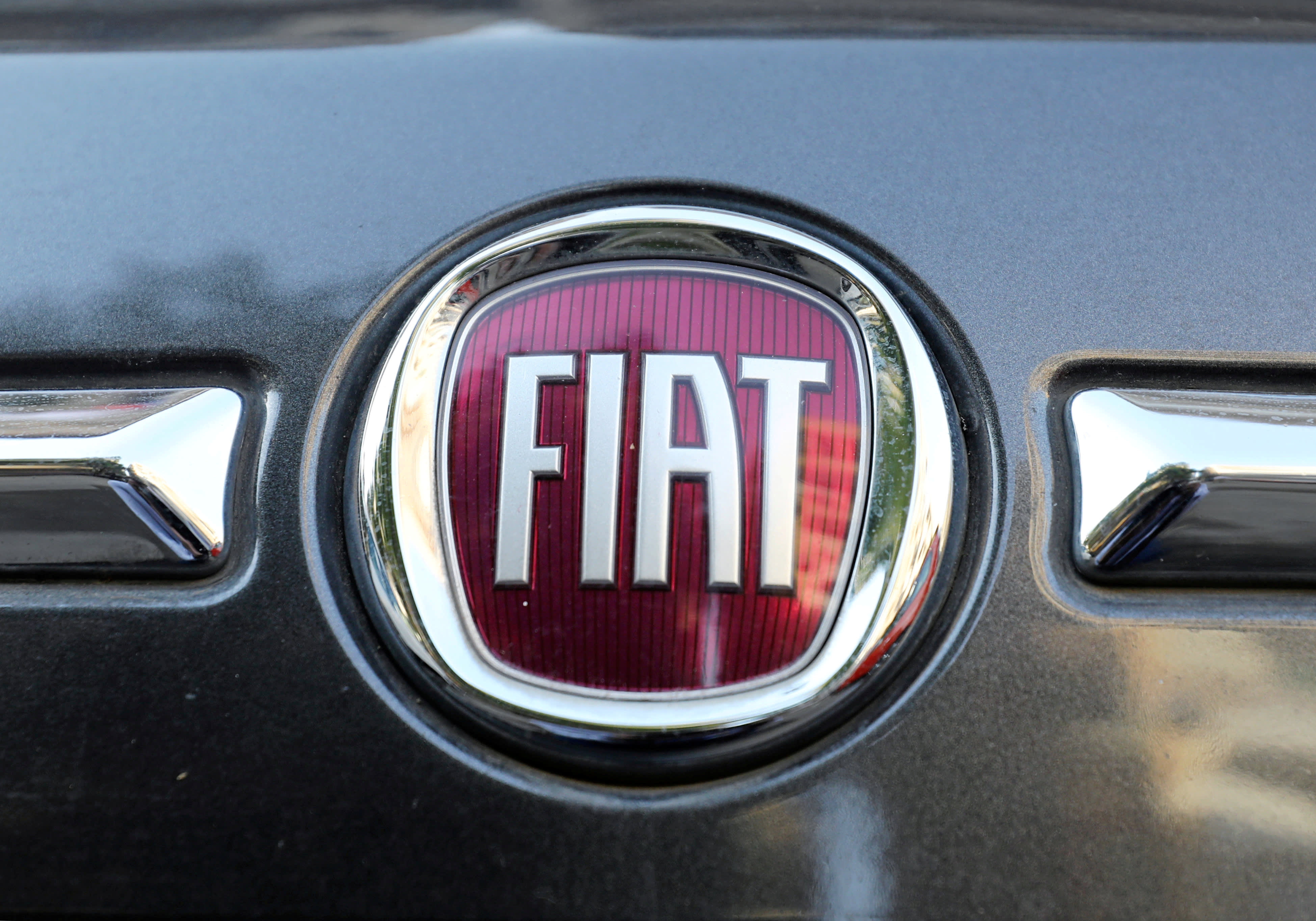 FILE PHOTO: The logo of FIAT carmaker is seen on a vehicle in Cairo, Egypt, May 19, 2019. Picture taken May 19, 2019. REUTERS/Mohamed Abd El Ghany/File Photo