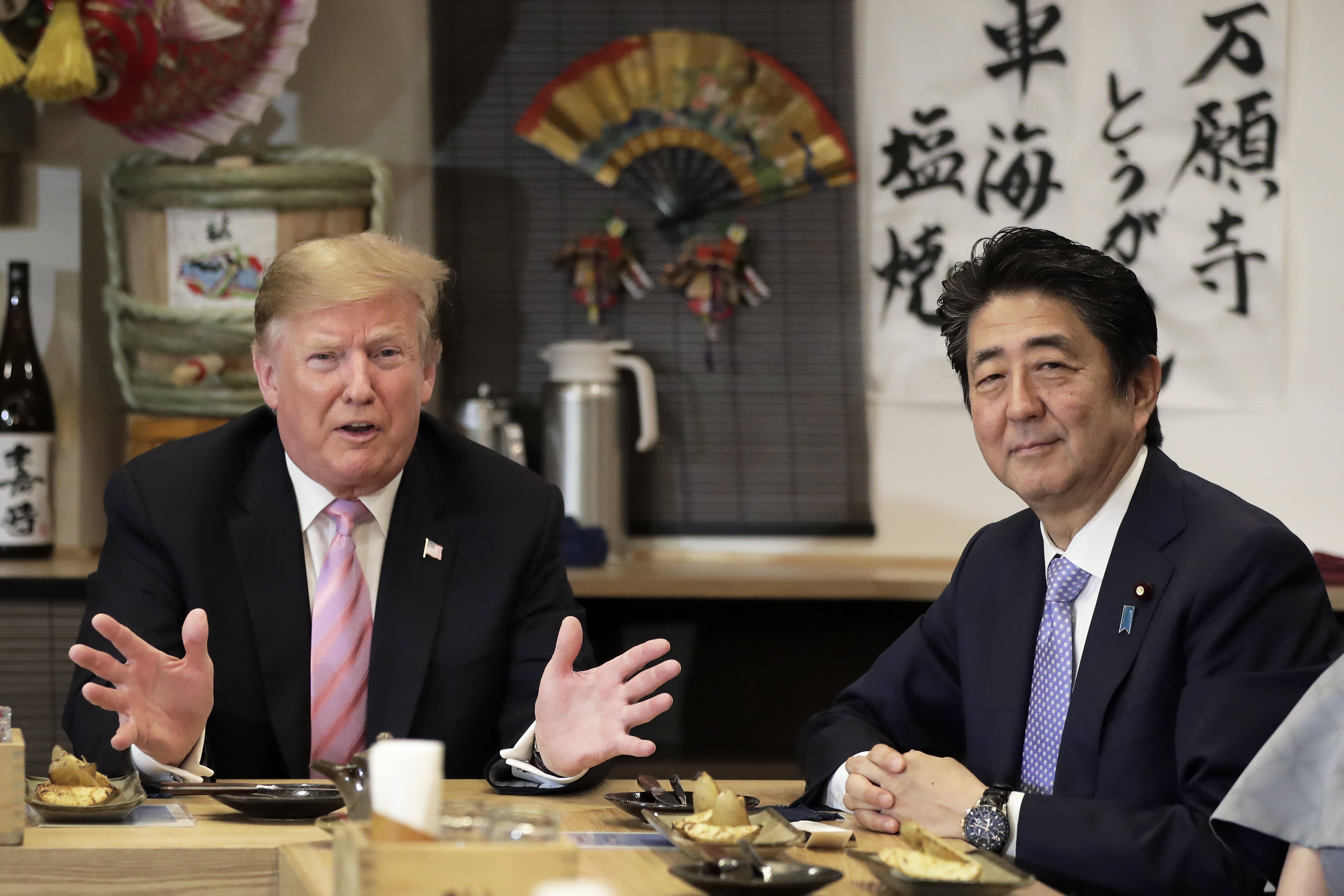 U.S. President Donald Trump, left, speaks as Shinzo Abe, Japan's prime minister, during a dinner at the Inakaya restaurant in the Roppongi district on May 26, 2019 in Tokyo, Japan.