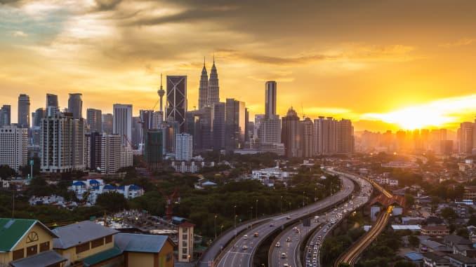 The Kuala Lumpur skyline at sunset in Malaysia.