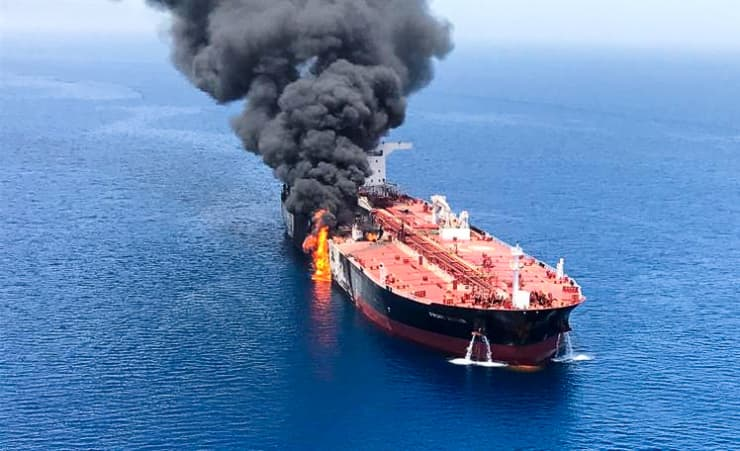 RT: An oil tanker is seen after it was attacked at the Gulf of Oman, June 13, 2019.
