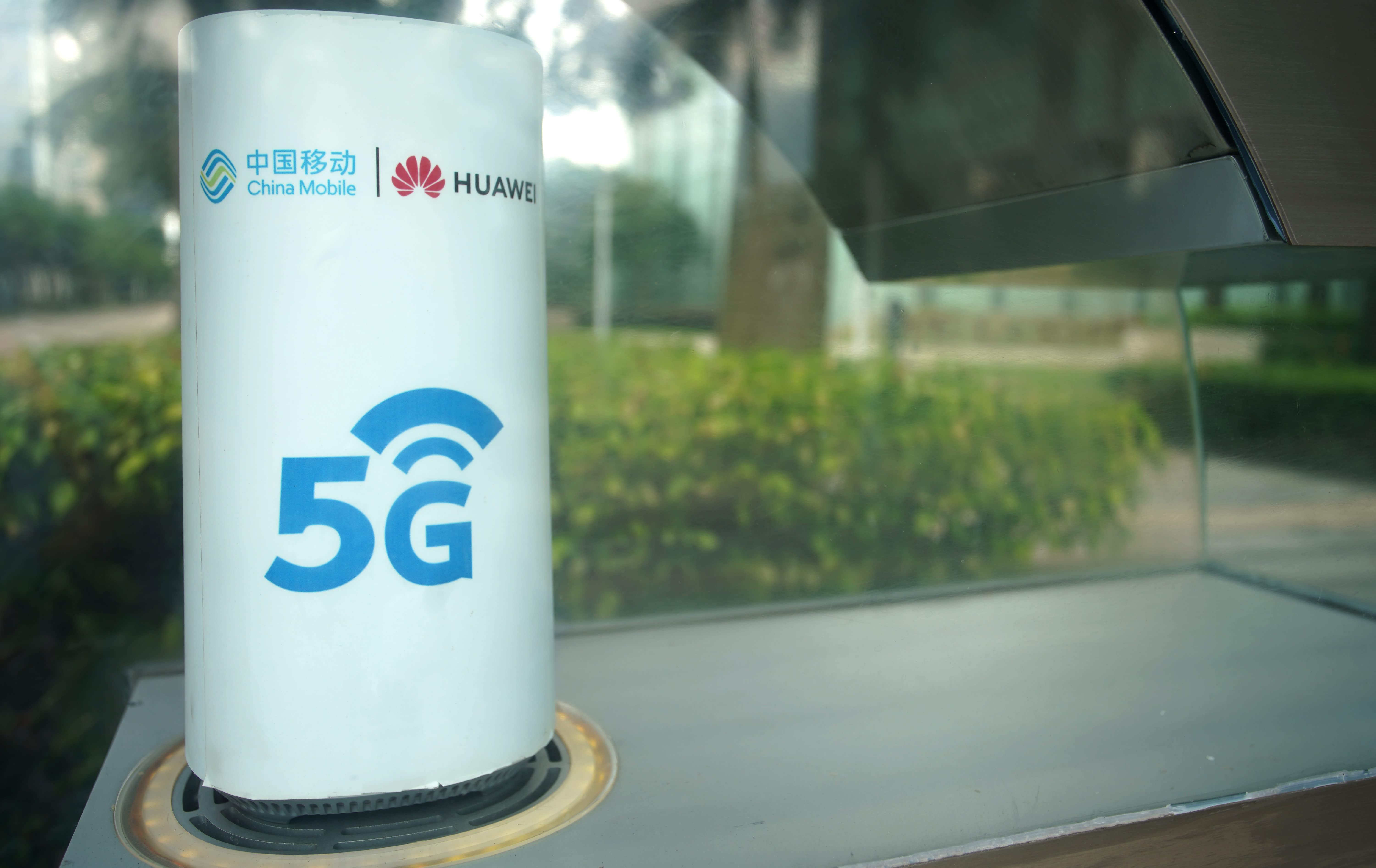 UK's new leader must urgently decide on including Huawei in 5G network, lawmakers say